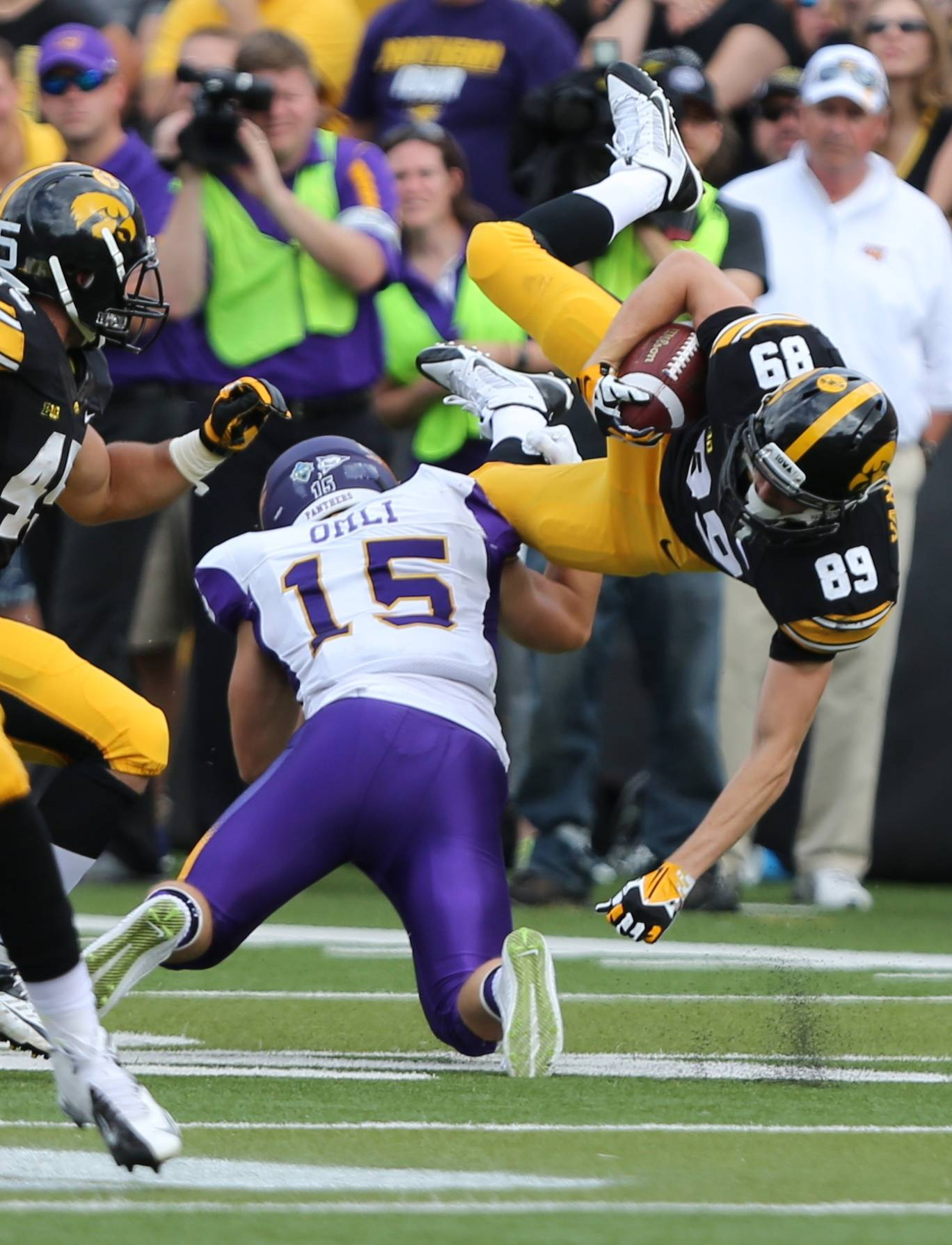 Iowa wide receiver Matt Vandeberg is upended by Northern Iowa defensive back Tate Omli on a kickoff return Saturday during the first half.