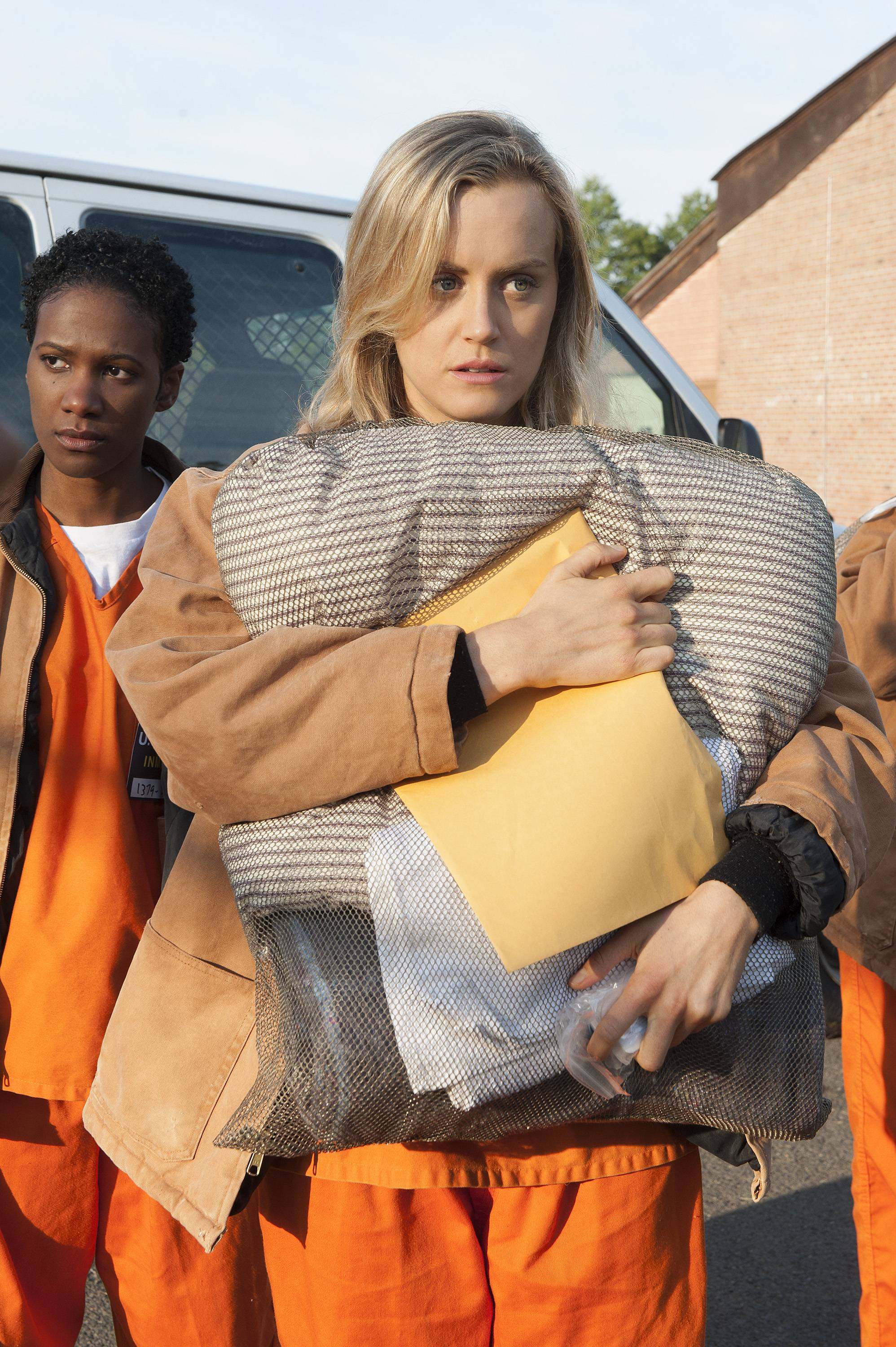 "This file image released by Netflix shows Taylor Schilling in a scene from ""Orange is the New Black."""