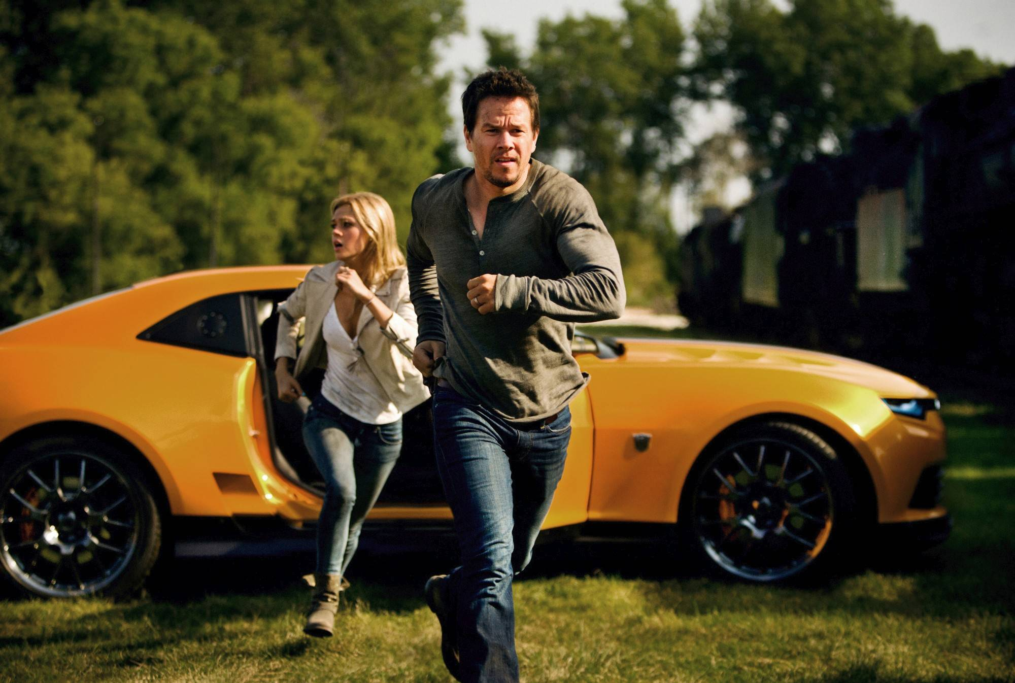 "Nicola Peltz and Mark Wahlberg in a scene from ""Transformers: Age of Extinction,"" which is the only film to rake in $1 billion at the box office this year."