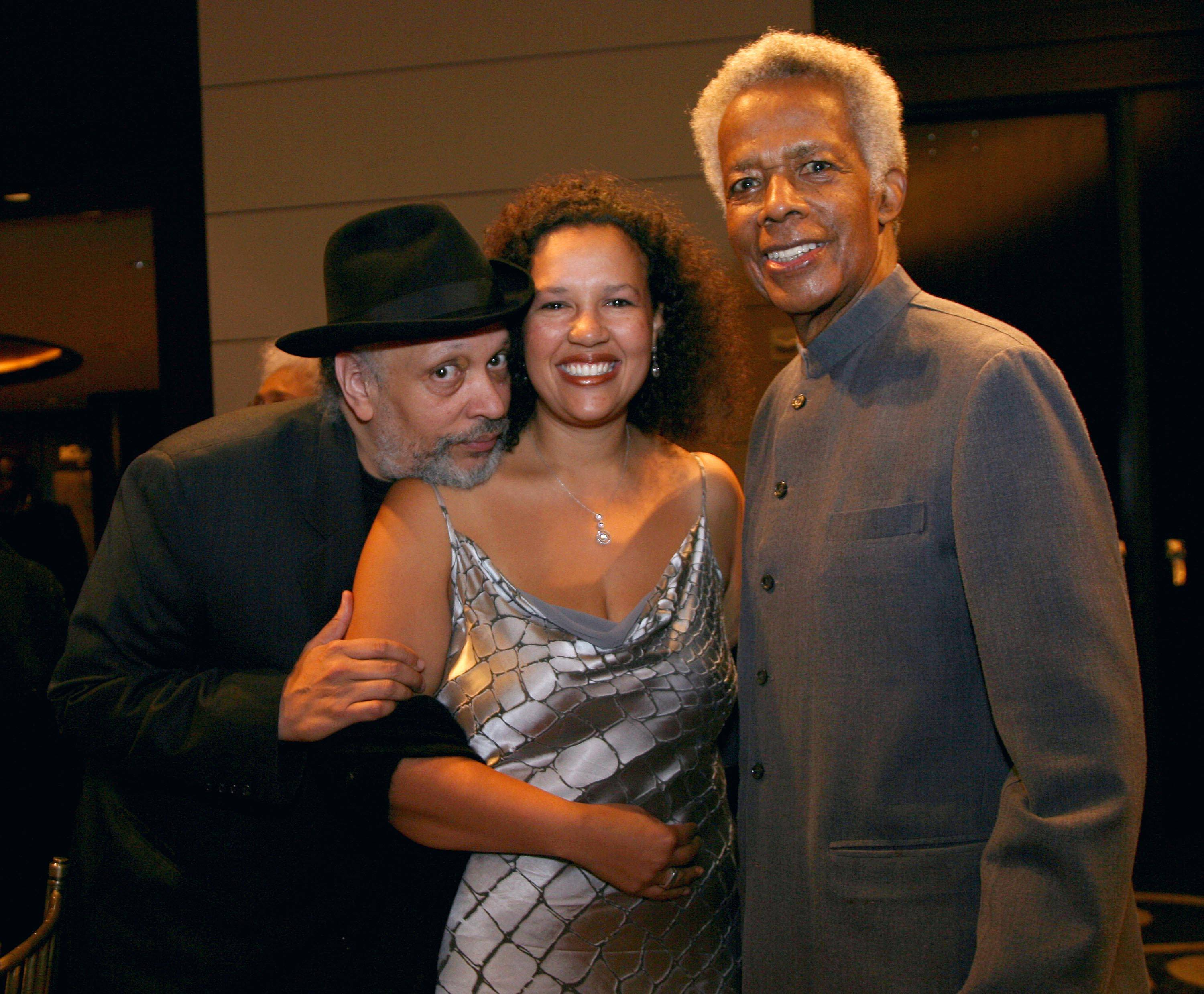 Walter Mosely, left, Elinor R. Tatum, publisher and editor-in-chief of the Amsterdam News, center, and documentary filmmaker William Greaves  attend the 80th anniversary celebration of Harlem's Schomburg Center at Jazz at Lincoln Center in New York.