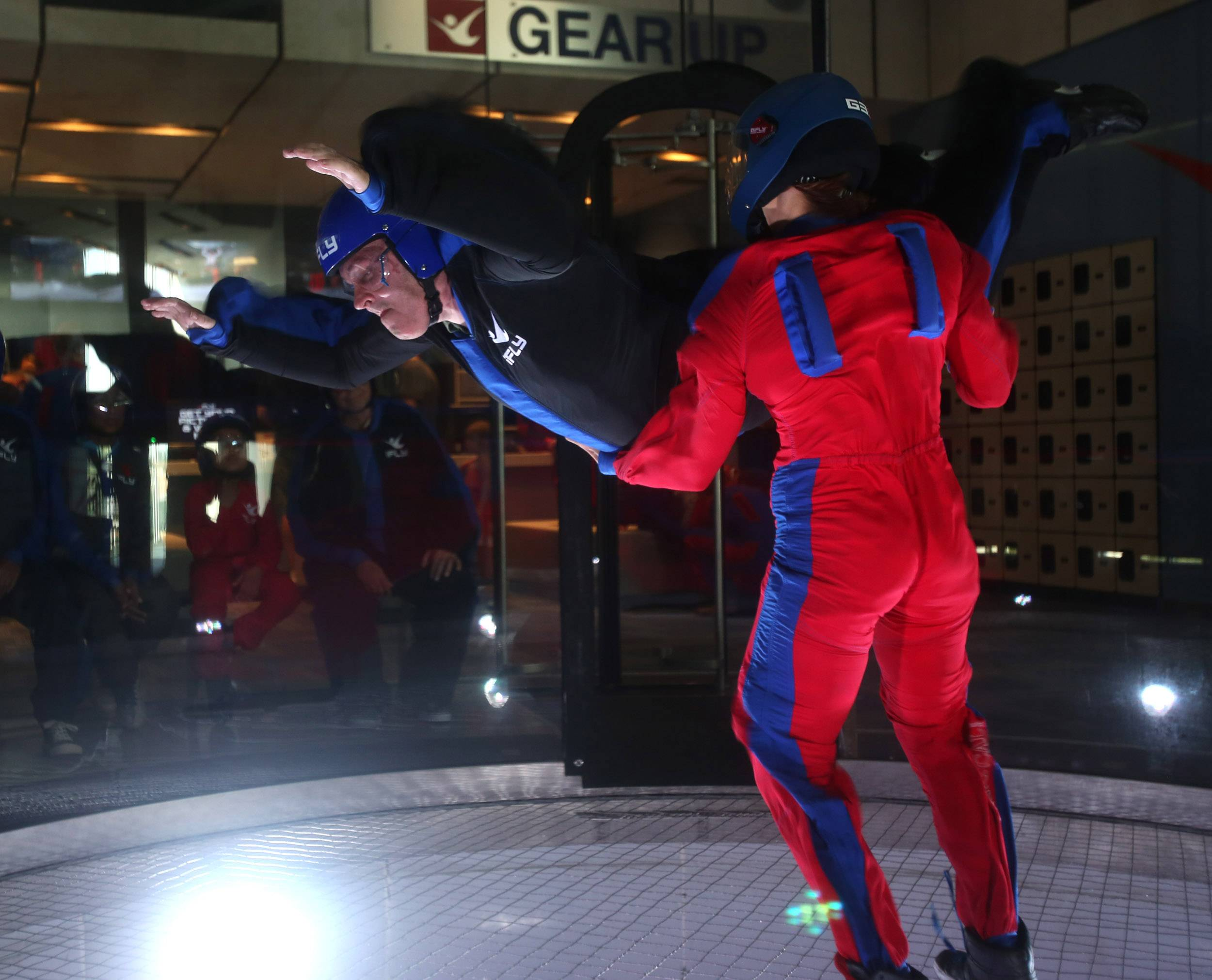 Otto Becker, 67, of Aurora is blind but able to experience the rush of indoor sky diving at iFly in Naperville, thanks to instructor Kristin Miller.