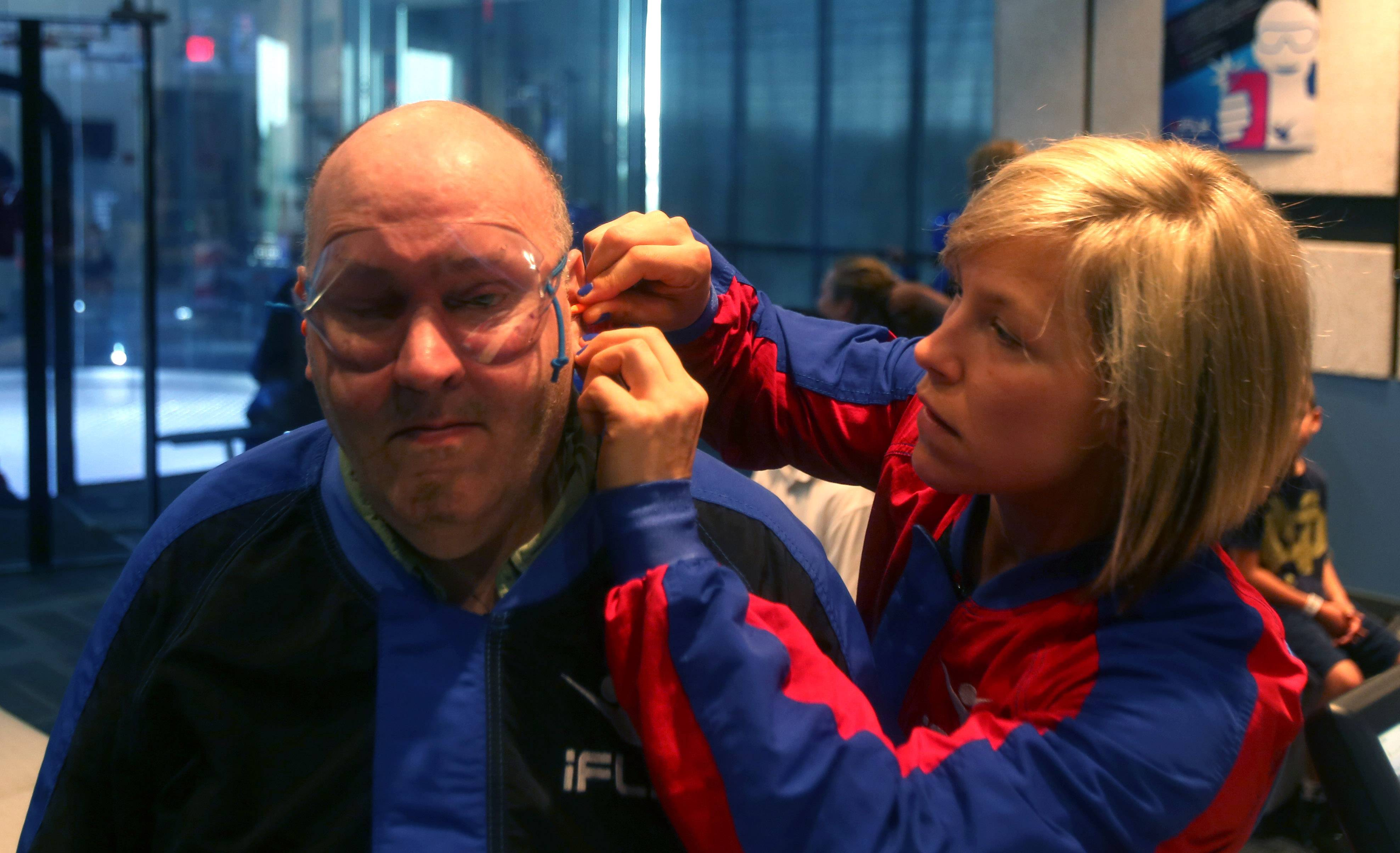 Otto Becker, 67, of Aurora is blind but ready to experience the rush of indoor sky diving at iFly in Naperville. Instructor Kristin Miller adjusts Becker's eye protection.