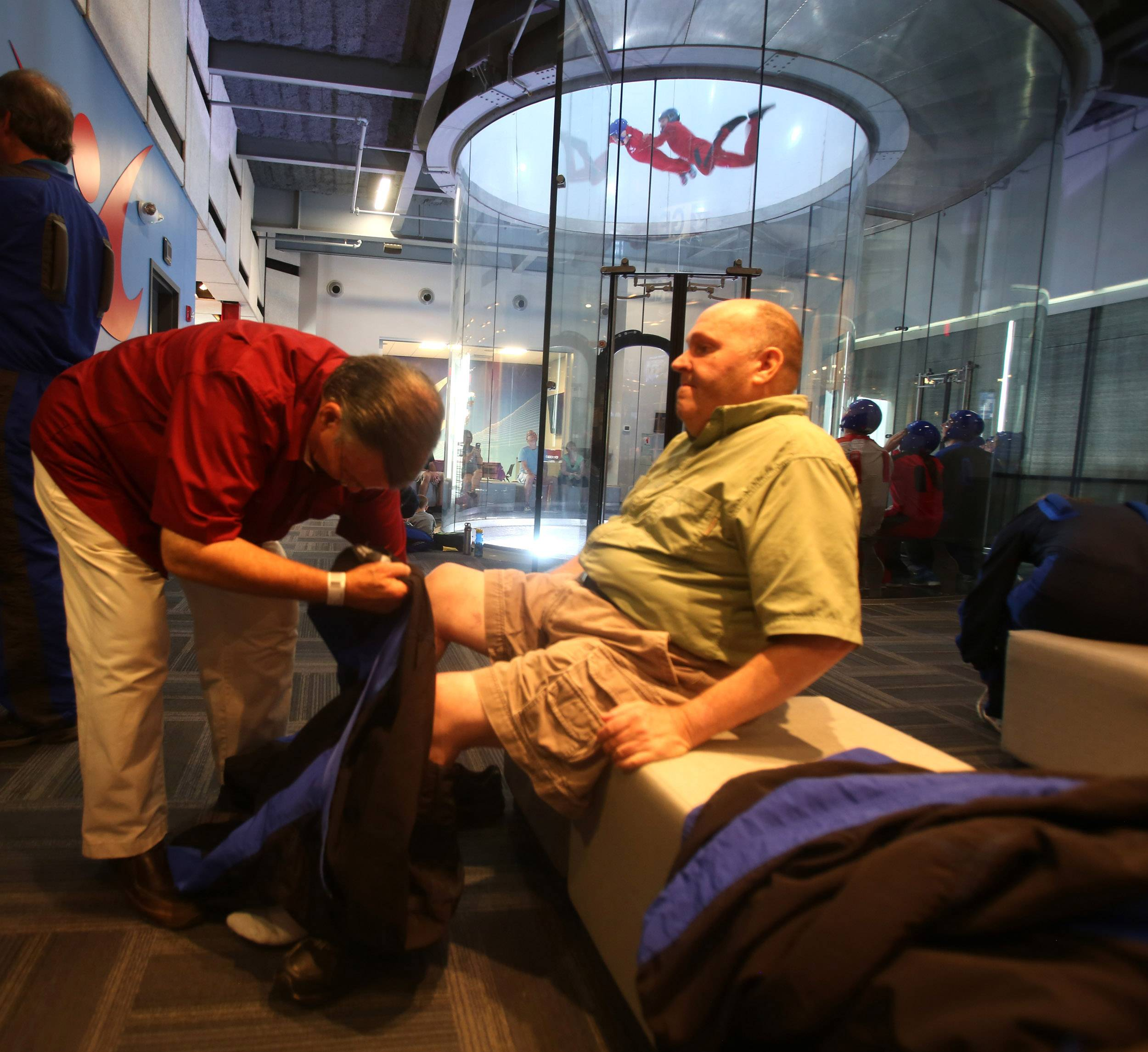Otto Becker, 67, of Aurora is blind and ready to experience the rush of indoor sky diving at iFly in Naperville. His friend Dan Coyne helps Otto get into his flight suit.