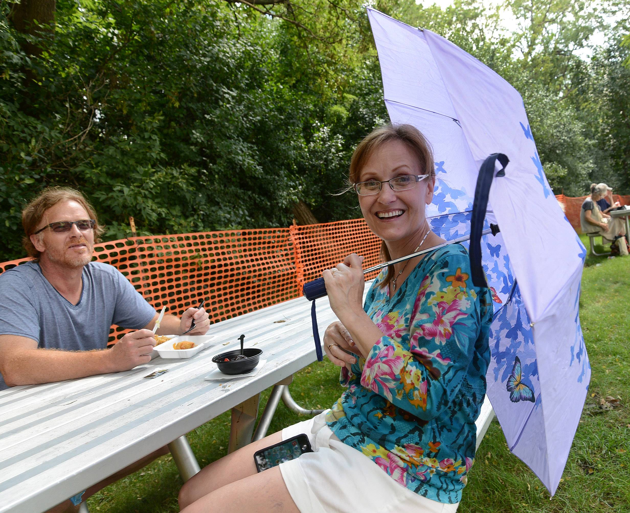 Kathi and Don Pasler of Mount Prospect enjoy a quiet place to have lunch on the first day of Schaumburg's 44th annual Septemberfest.