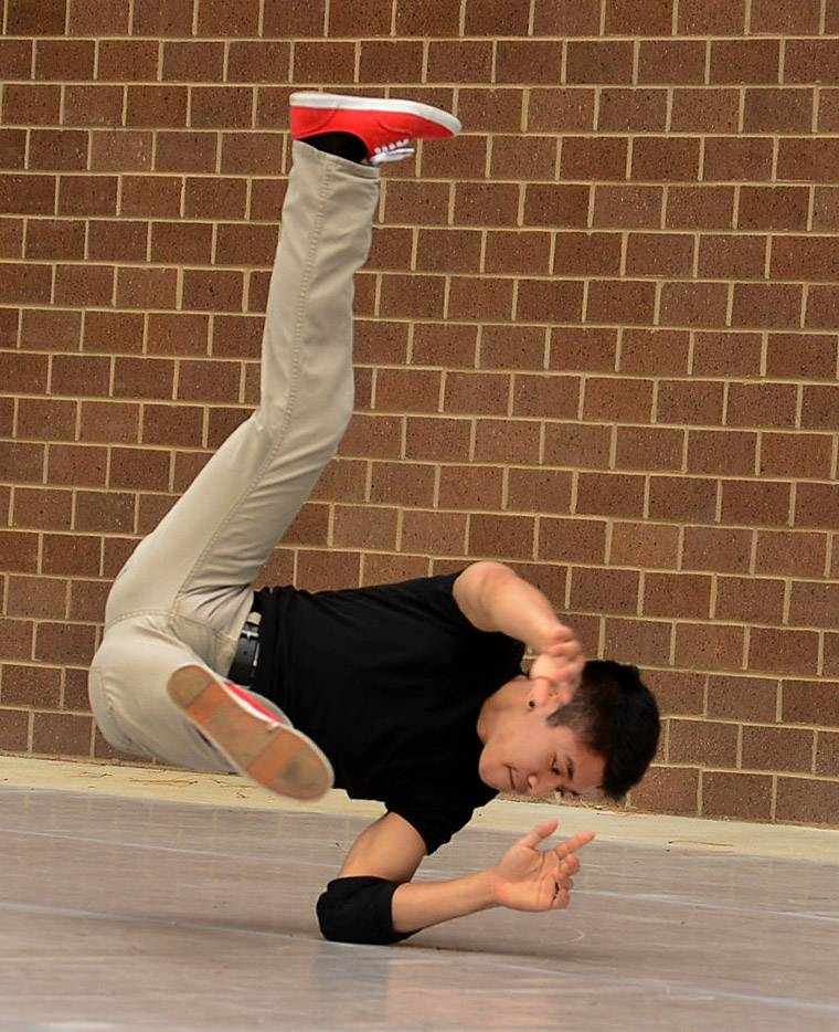 Juan Hernandez, instructor for the Schaumburg Park District Impact Competition Dance Team, demonstrates some moves on the first day of Schaumburg's 44th annual Septemberfest.