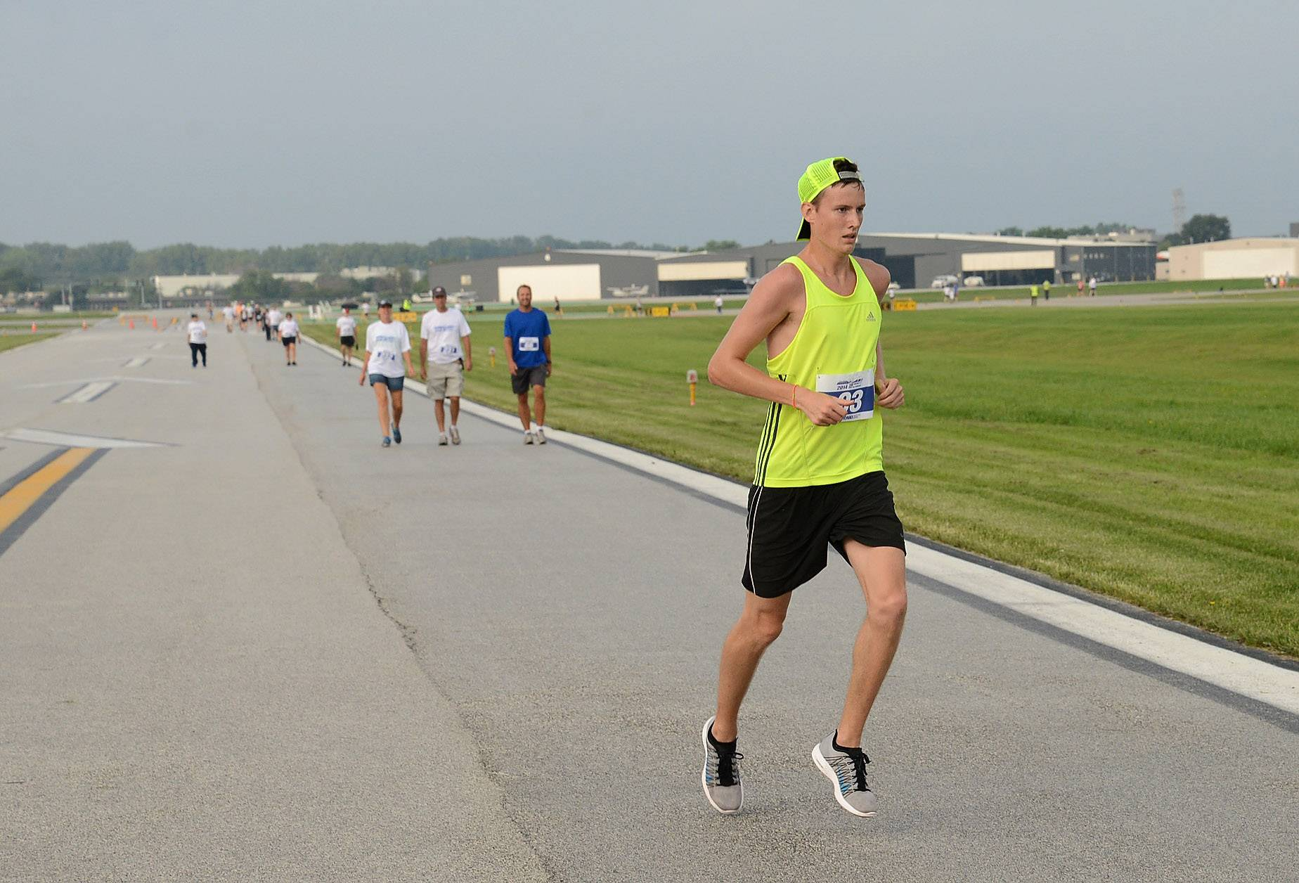 Ryan Kearns of Prospect Heights heads for the finish with a winning time of 17:28 during the Run the Runway 5K Run and 1 Mile Walk at Chicago Executive Airport in Wheeling.