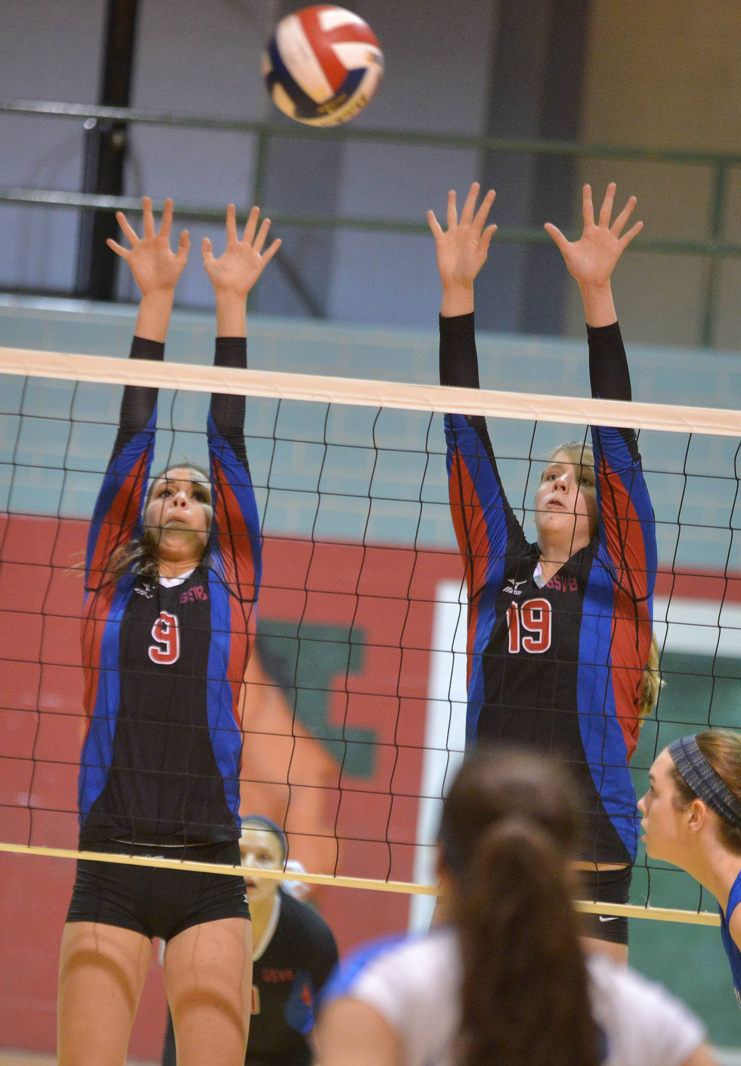 Alex LaPonte of Glenbard South,left, and Sydney Bauman  go up for a block during the Glenbard South vs. Lyons Twp. at Class 4A Morton girls volleyball sectional semifinal.