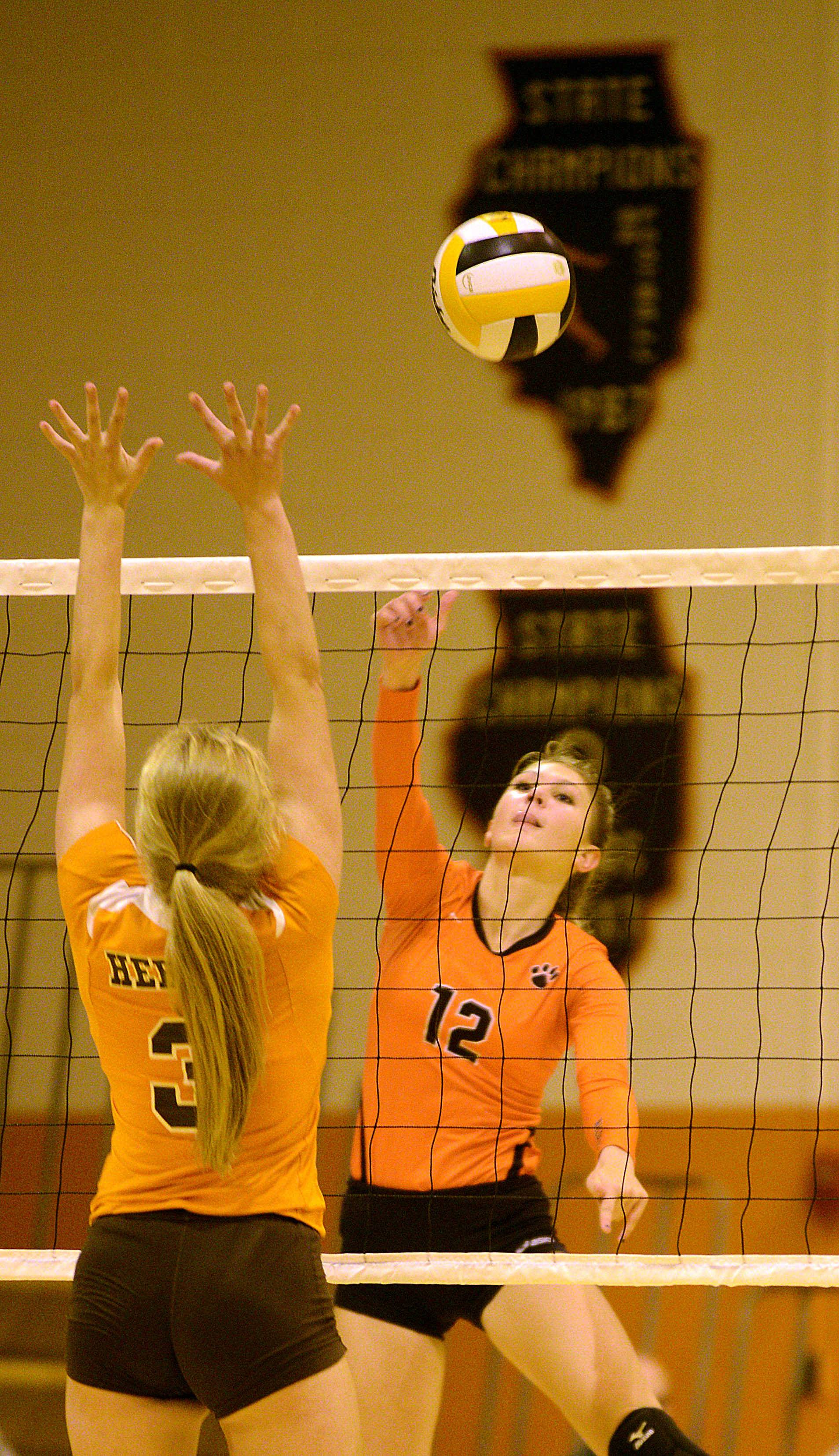 Libertyville's Anna Lillydahl drives home an attack during the Wildcats' three-set victory Monday at Hersey.
