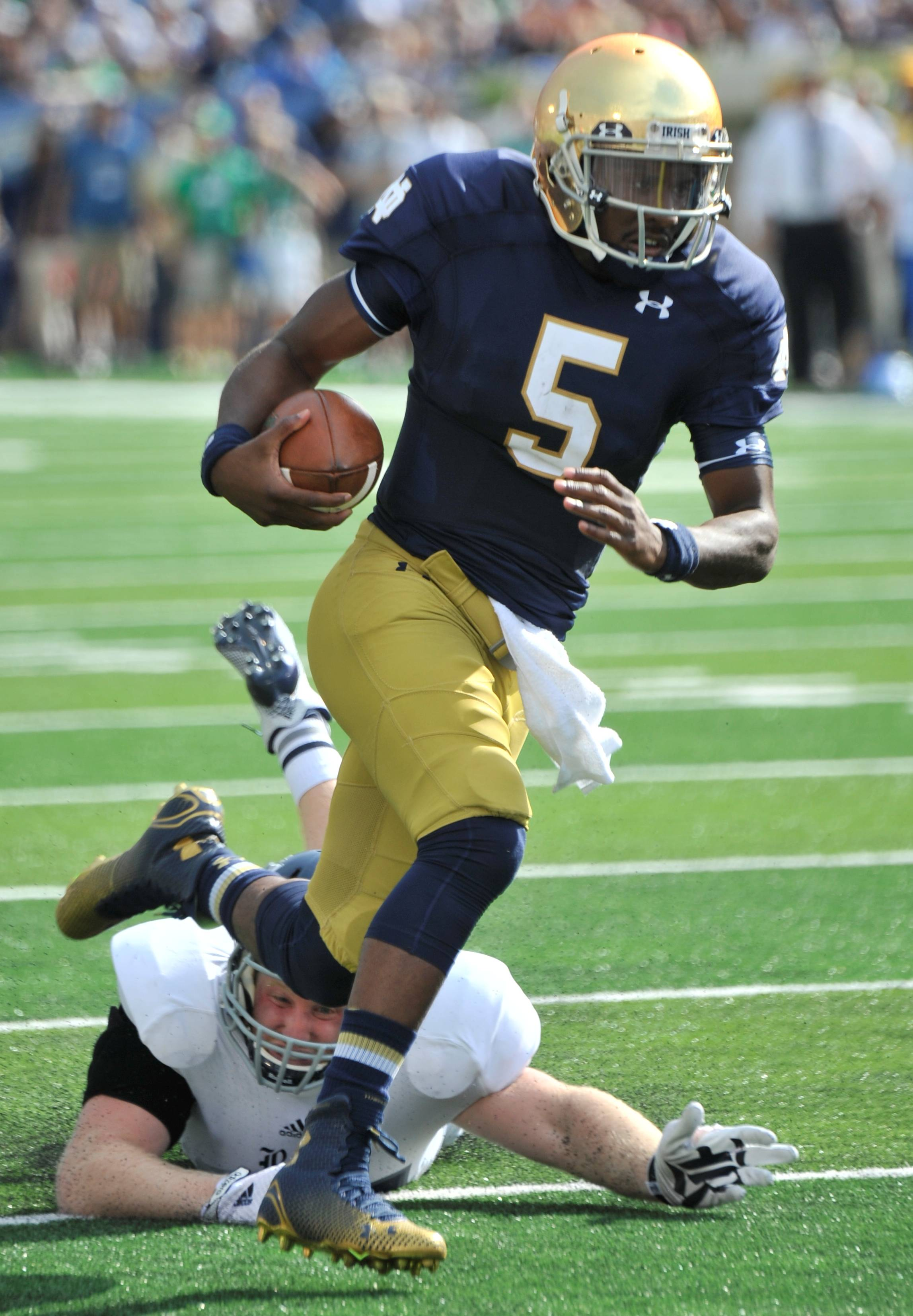 Notre Dame quarterback Everett Golson (5) heads toward the end zone during Saturday's game with Rice in South Bend, Ind. Notre Dame won 48-17.