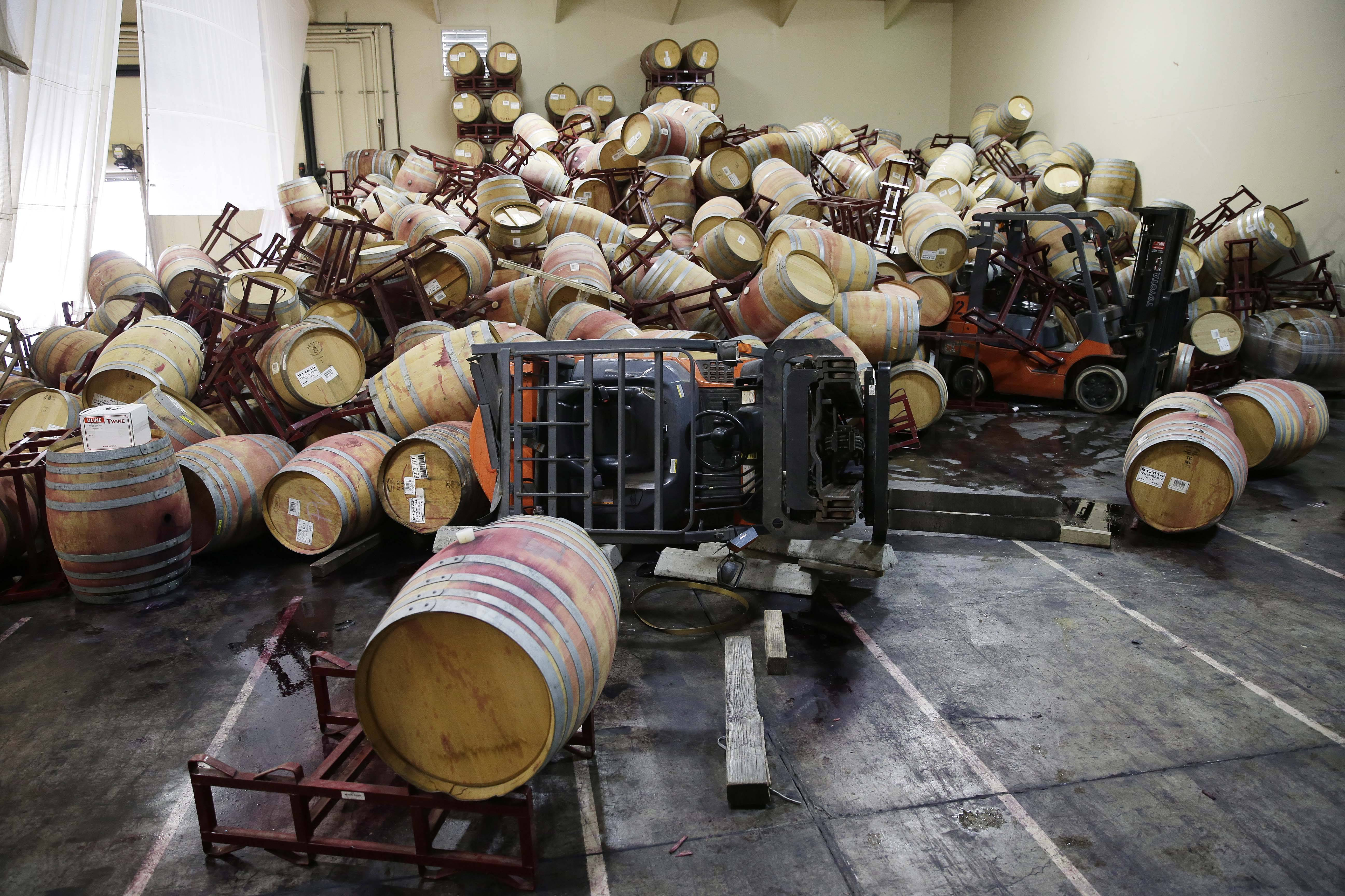 Some of the hundreds of earthquake damaged wine barrels cover and toppled a pair of forklifts at the Kieu Hoang Winery in Napa, California. A powerful earthquake that struck the heart of California's wine country caught many people sound asleep, sending dressers, mirrors and pictures crashing down around them and toppling wine bottles in vineyards around the region. The magnitude-6.0 quake struck at 3:20 a.m. PDT Sunday near the city of Napa.