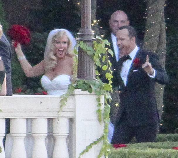 Actress Jenny McCarthy and Donnie Wahlberg walk along the Fox River after they were married Sunday at the Hotel Baker in St. Charles.