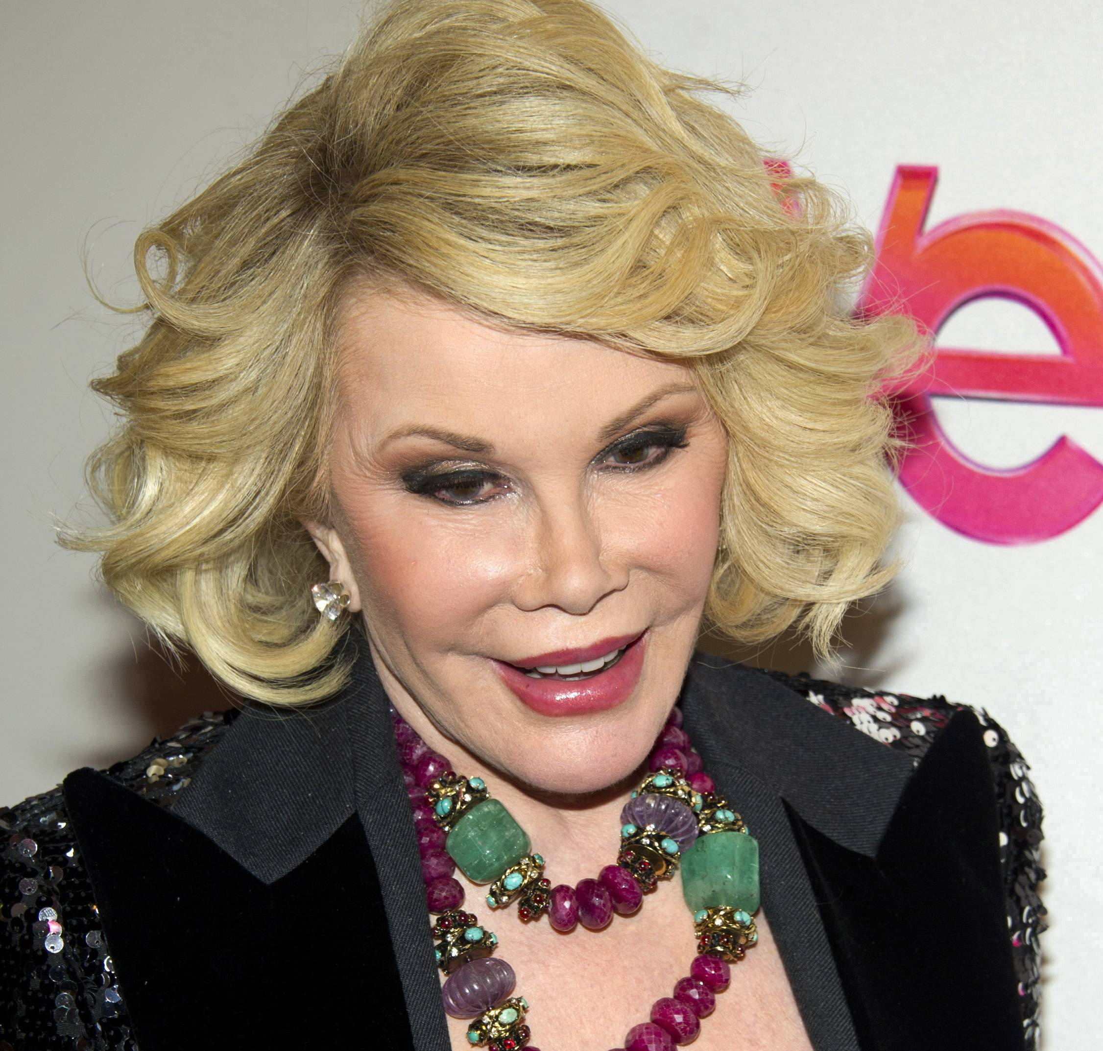 "In this Jan. 19, 2012, file photo, Joan Rivers attends a screening of the Season 2 premiere of WE TV's ""Joan & Melissa: Joan Knows Best?"" in New York. Rivers was been rushed in cardiac arrest from a doctor's office Thursday to a New York City hospital. Rivers' daughter Melissa says they are hopeful about her condition despite her continuing hospitalization."