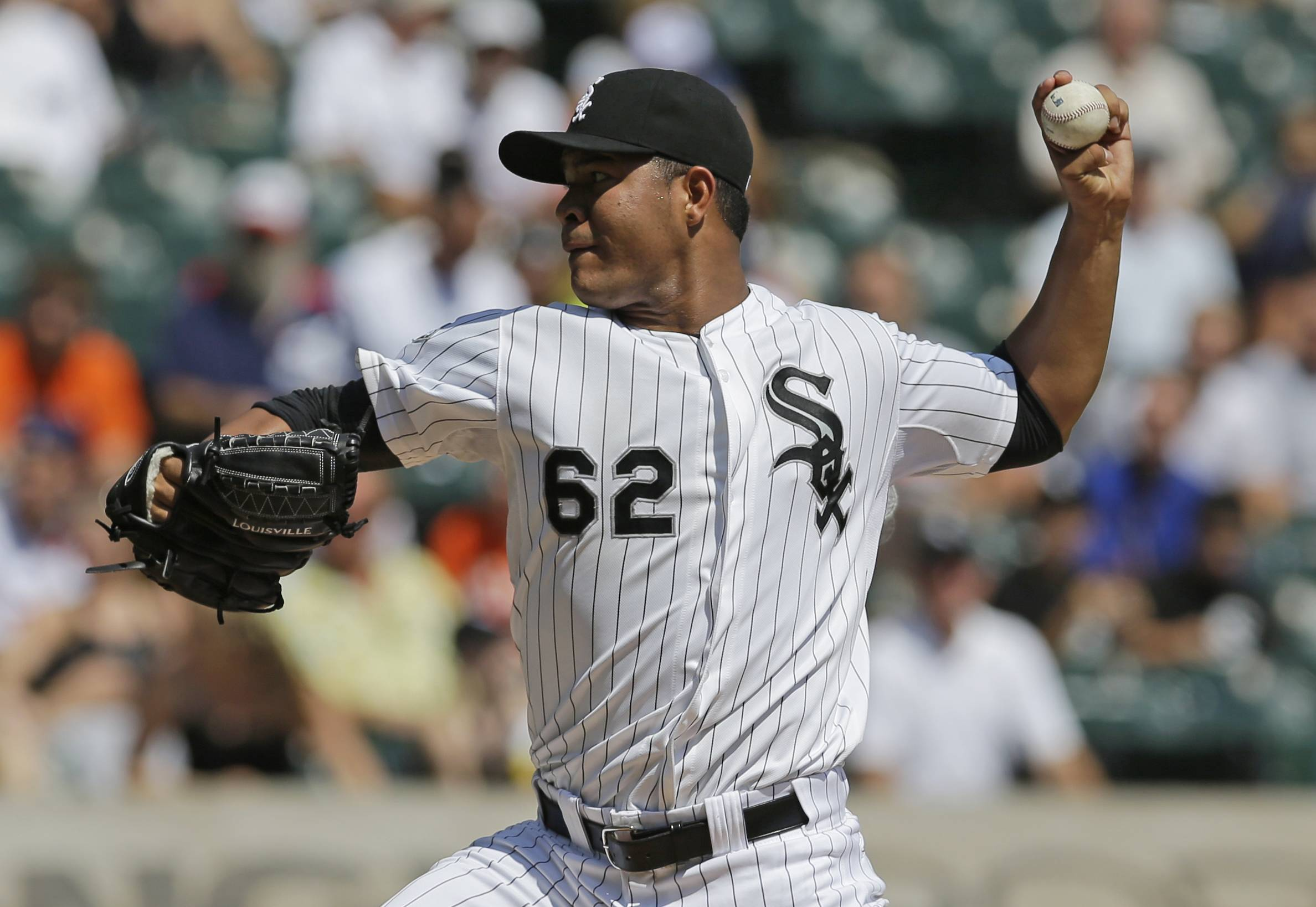 White Sox starter Jose Quintana throws against the Detroit Tigers during the first inning of a baseball game in Chicago, Sunday, Aug. 31, 2014.