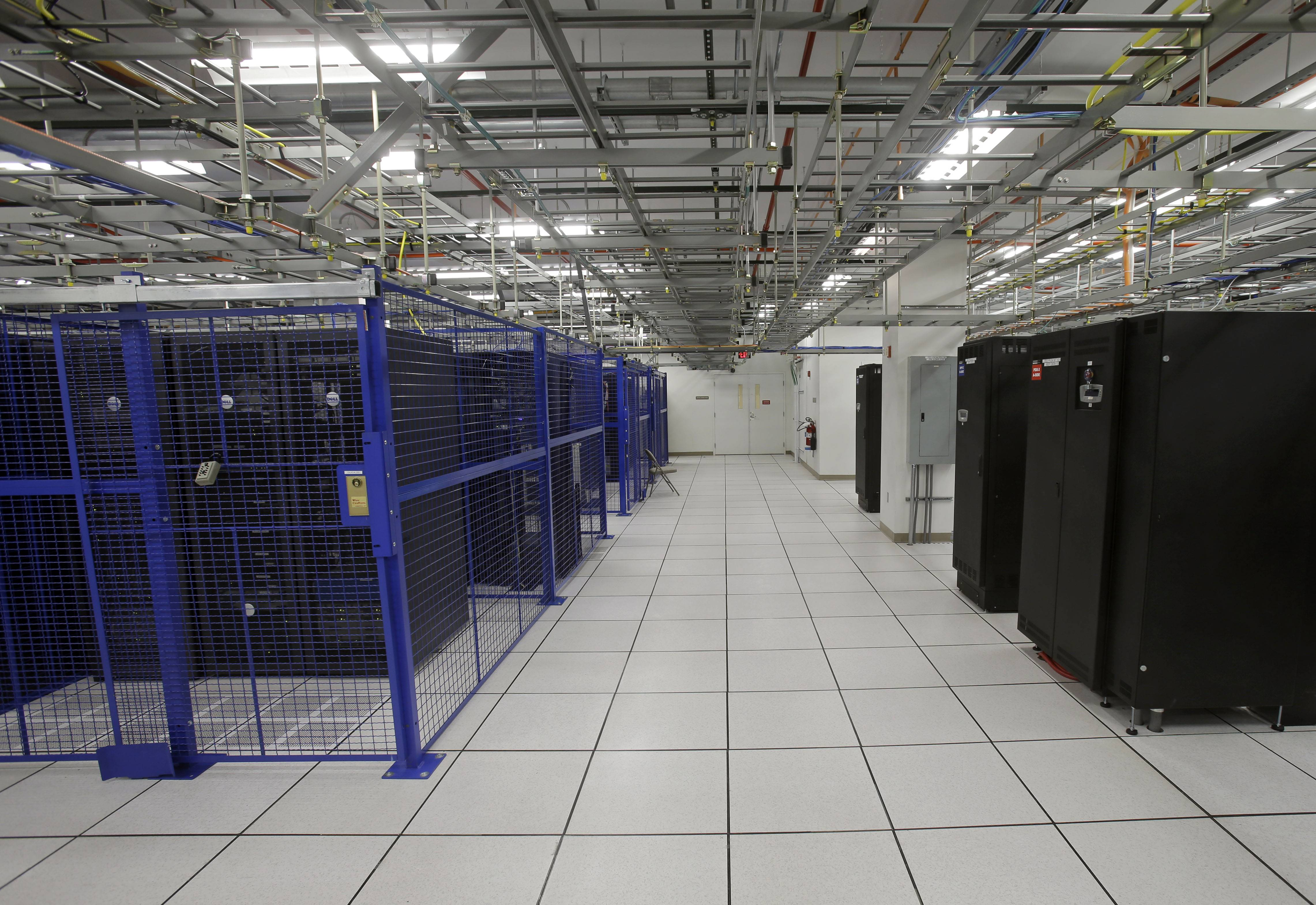 Racks of servers are protected by steel cages at BlueBridge Networks in Cleveland. A growing number of data centers, like BlueBridge, are choosing to locate in and around the city to take advantage of cheap power, a growing customer base and one of the safest environments in the country for storing digital information.