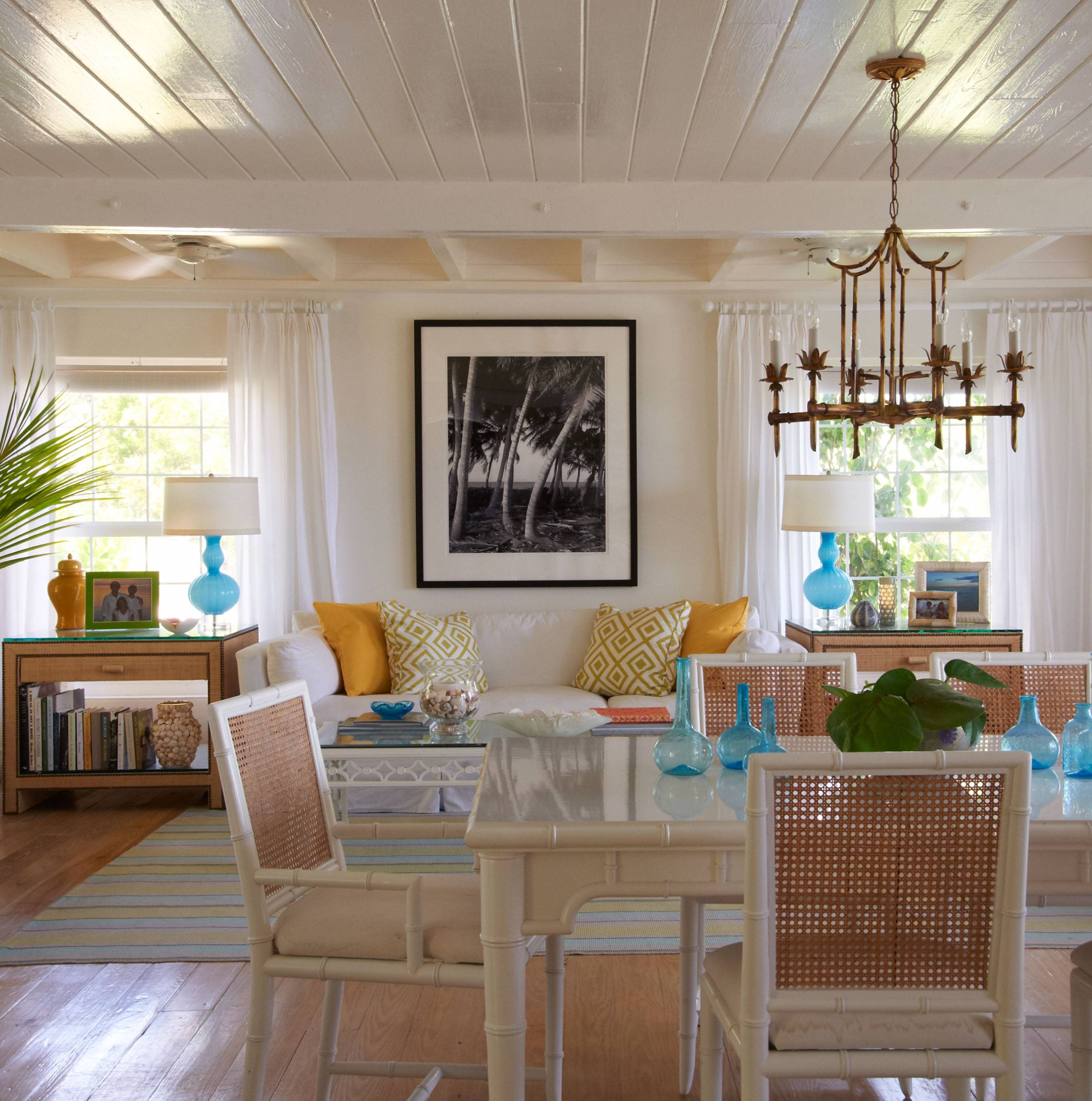 This living and dining room in a home in Harbour Island in the Bahamas was decorated by interior designer Jan Showers.
