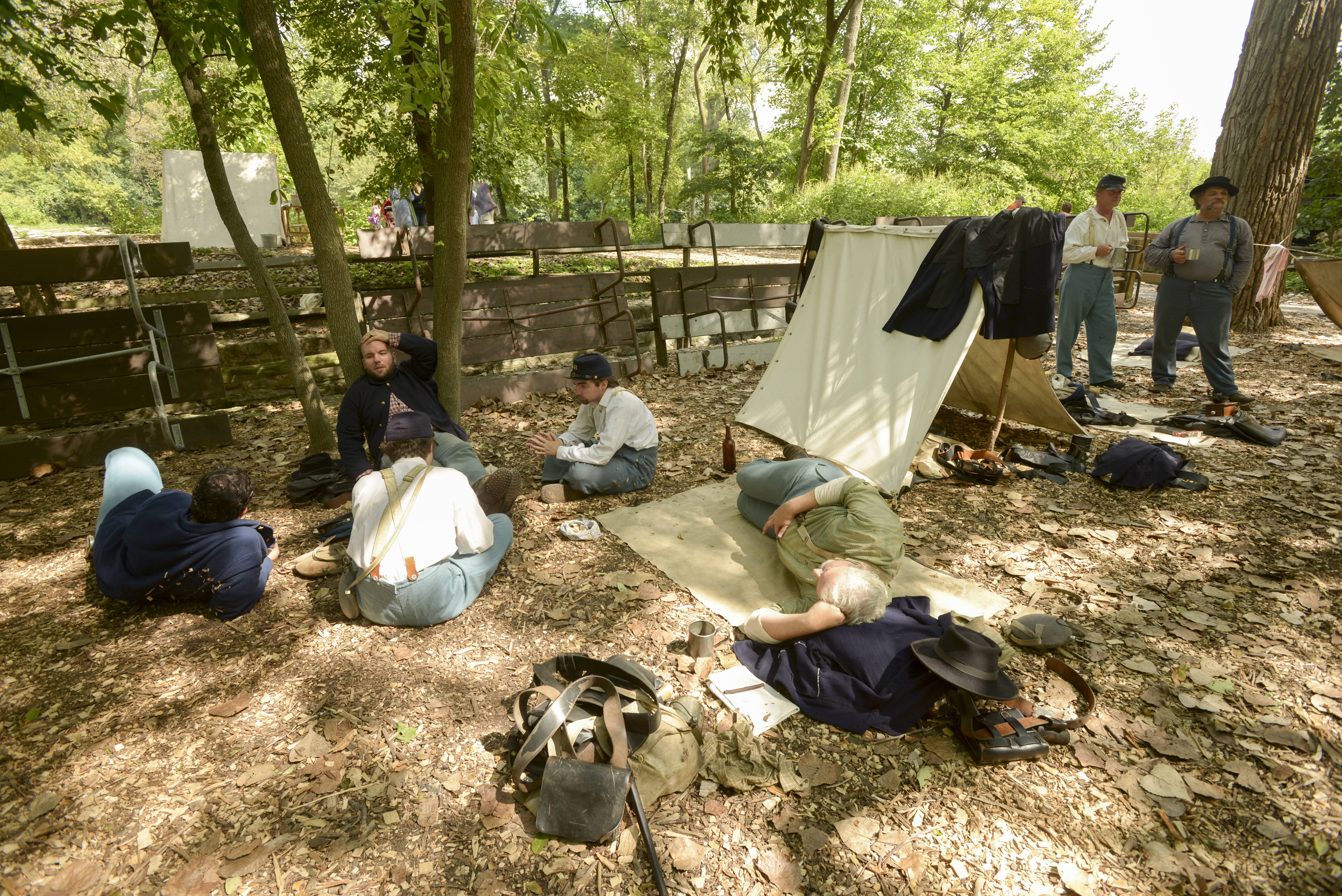 Re-enactors serving as Union Army soldiers relax Sunday during the Civil War Encampment at Graue Mill and Museum in Oak Brook.