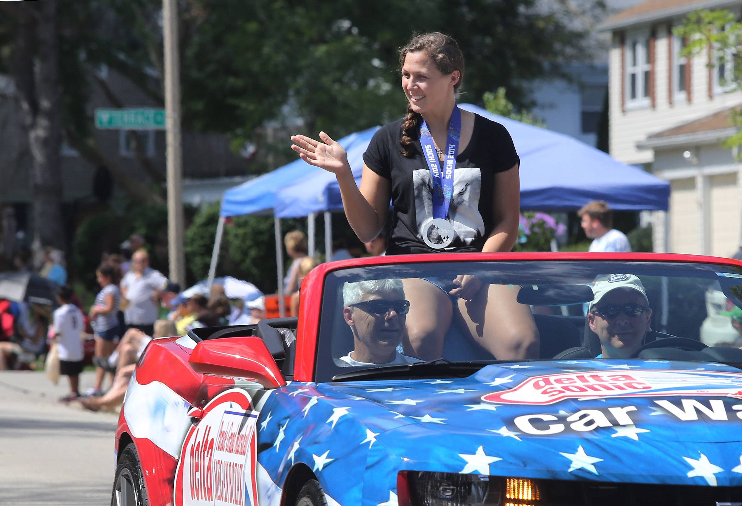 Olympic silver medalist Megan Bozek waves to the crowd Sunday during the Buffalo Grove Days parade along Bernard Drive. The U.S. women's ice hockey player was this year's grand marshal in what organizers say was the largest ever Buffalo Grove Days parade..