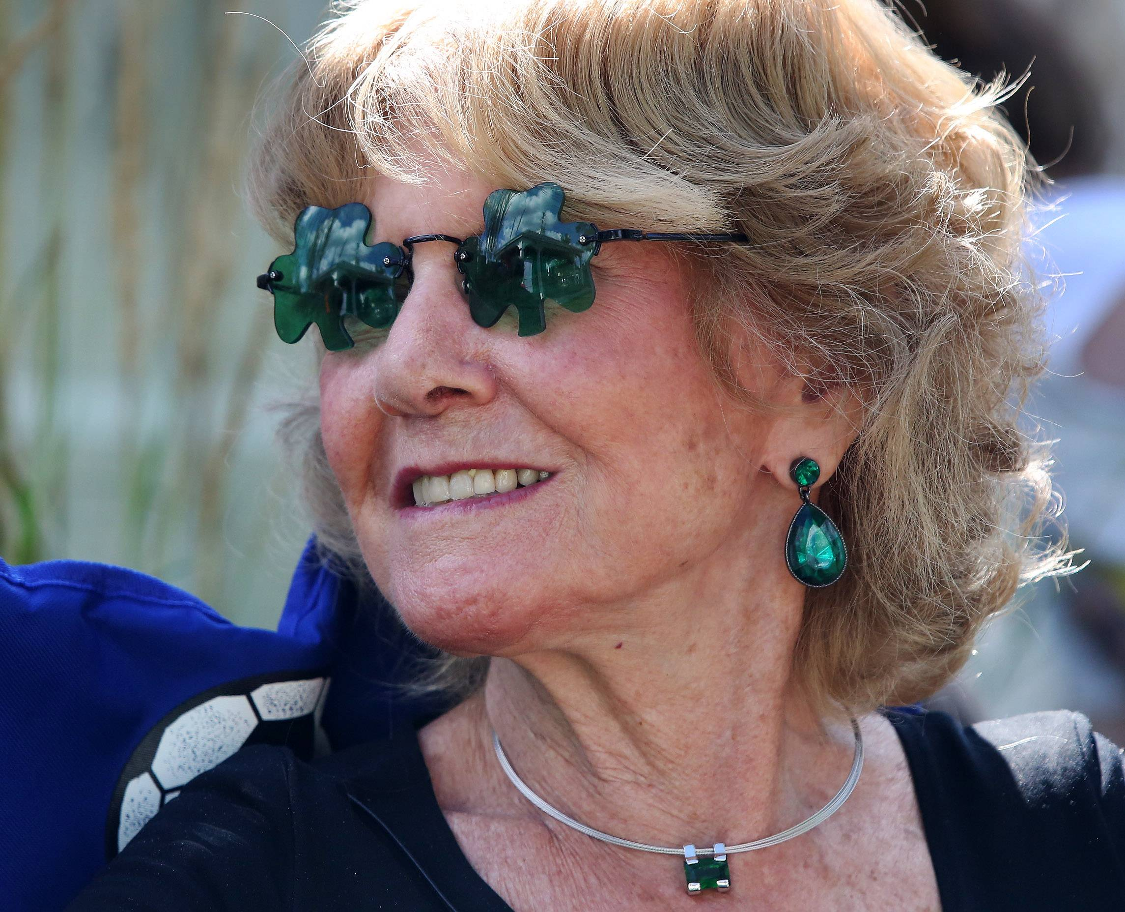 Mary Gallagher of Lake Bluff wears shamrock shaped sunglasses Sunday during the Long Grove Irish Days Festival in the village's historic downtown. The festival featured live music, Irish dancers, a men-in-kilts competition and more.
