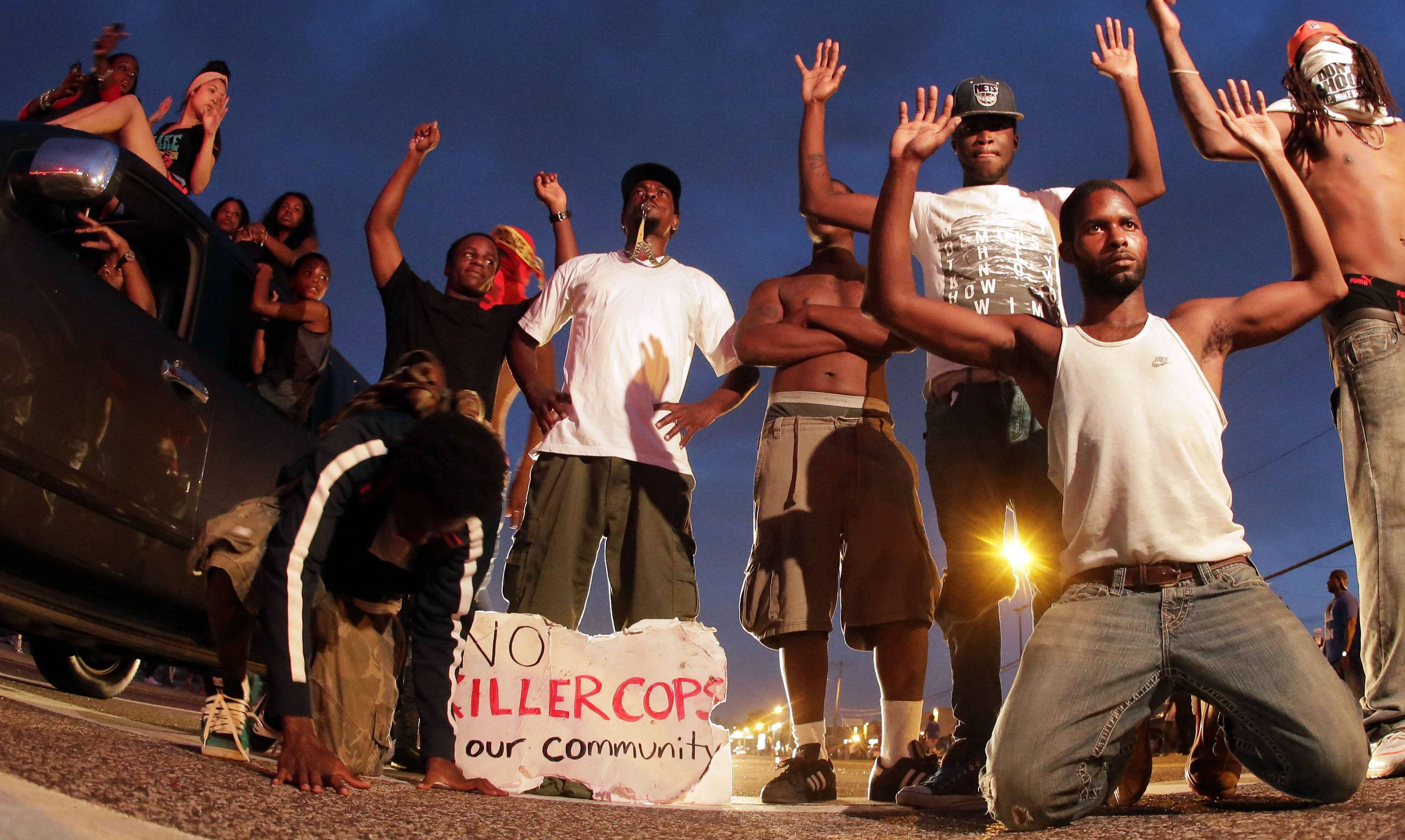 People protest for Michael Brown, who was killed by a police officer in Ferguson, Mo., in this Aug. 17 file photo.
