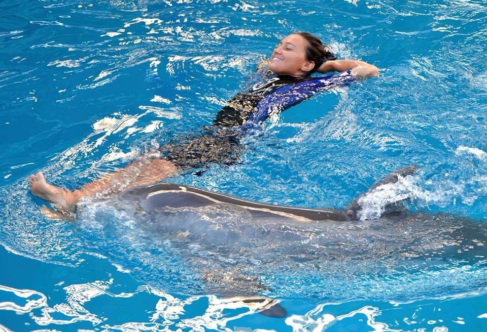 "Her job as an associate marine mammal trainer can be demanding, but Mallory Mara makes time to relax with her dolphin buddies at Clearwater Marine Aquarium in Florida, where the Elk Grove Village native works with Winter and Hope, the stars of the ""Dolphin Tale 2"" movie."
