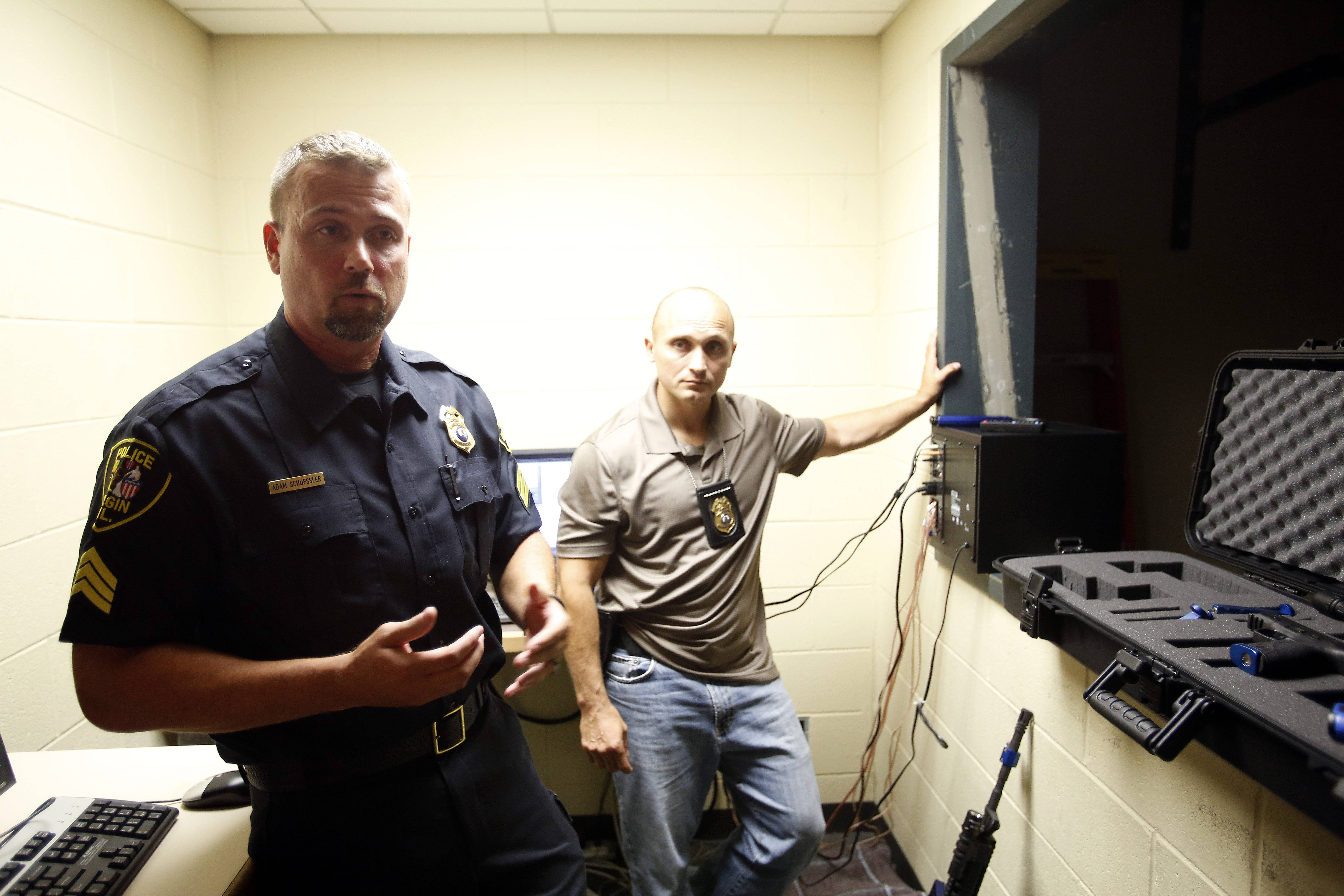 The Ti Training simulator cost about $65,000. The Elgin Police Department tested several models that cost up to $500,000 before purchasing it three months ago. Pictured Sgt. Adam Schuessler, left, and Lt. Frank Trost.
