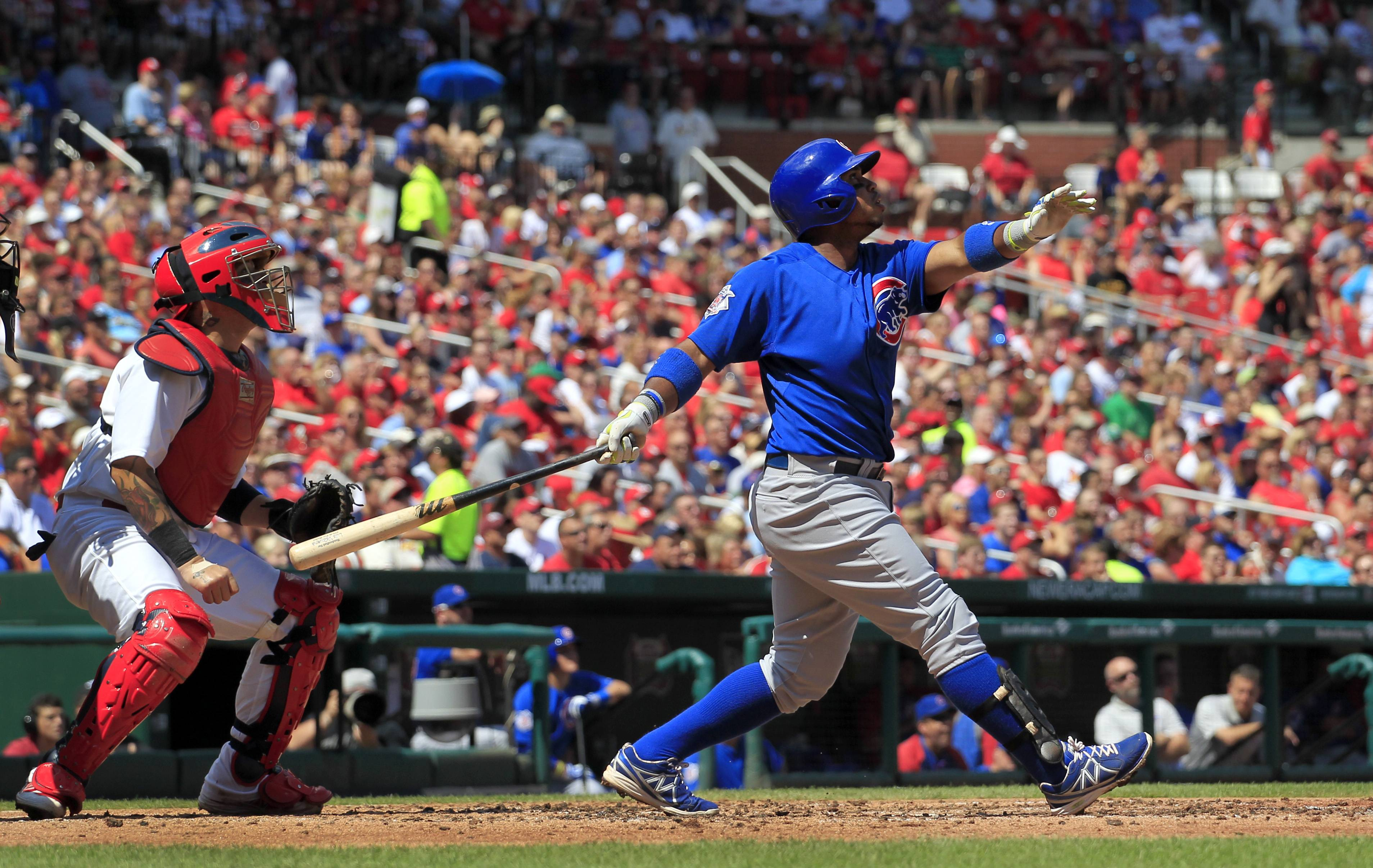 Chicago Cubs' Luis Valbuena, right, and St. Louis Cardinals catcher Yadier Molina watch Valbuena's two-run home run during the second inning of a baseball game Sunday, Aug. 31, 2014, in St. Louis.