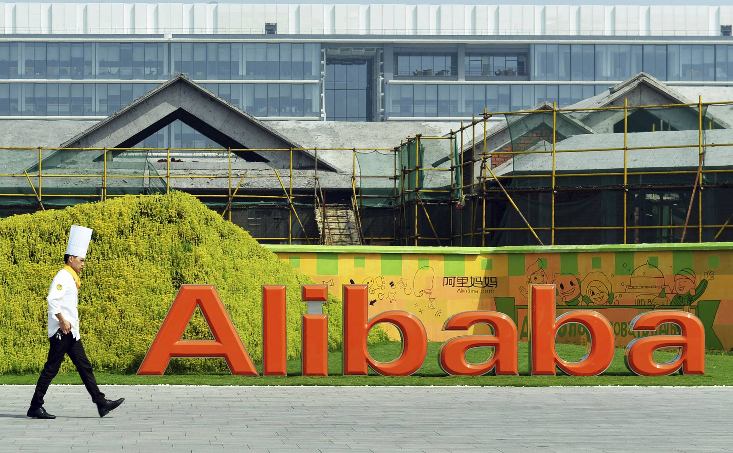 A chef walks in the headquarter campus of Alibaba Group in Hangzhou in eastern China's Zhejiang province. Foreigners who want to buy Alibaba Group shares in the Chinese e-commerce giant's U.S. public offering will need to get comfortable with an unusual business structure.