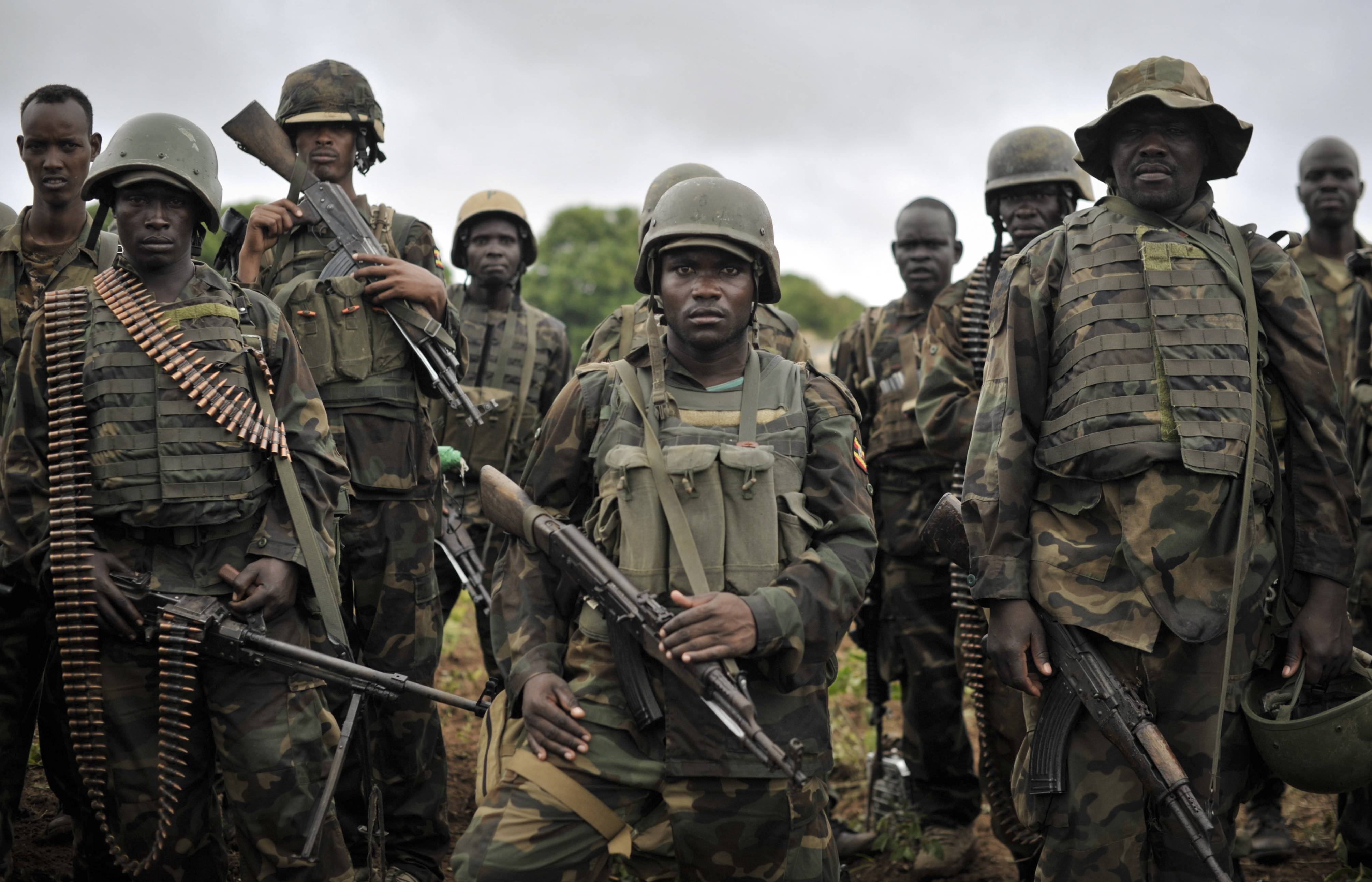 "In this photo taken Sunday, African Union soldiers from Uganda prepare to advance on the town of Kurtunwarey in Somalia. Somali government and AU troops have been engaging al-Shabab militants as part of their military offensive dubbed ""Indian Ocean"" aiming to oust al-Shabab from its last major hideouts in the southern parts of the Horn of Africa nation."