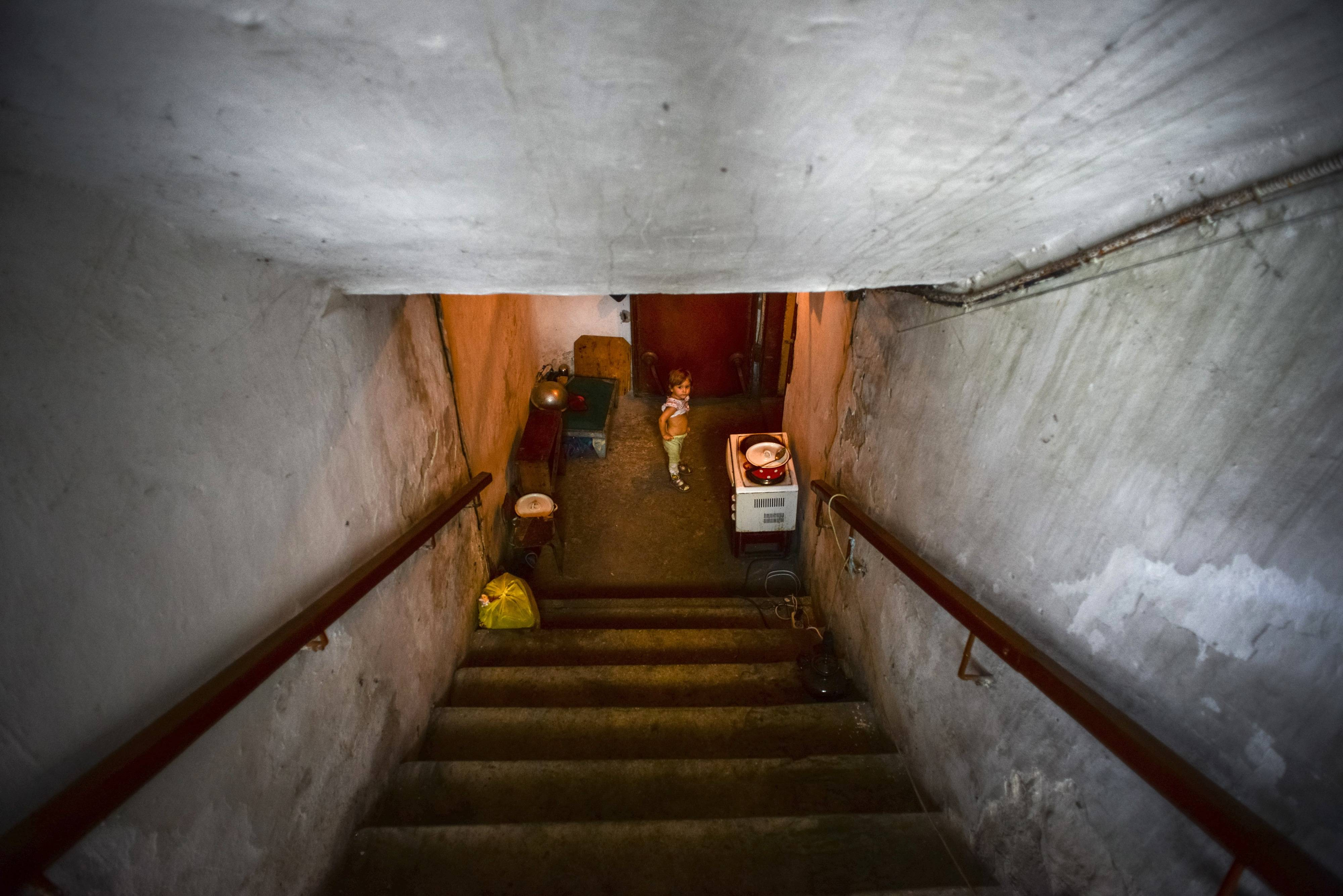 A little girl walks the stairs of the bomb shelter in Petrovskiy district in Donetsk, eastern Ukraine, Monday. Petrovskiy district of Donetsk is currently a frontline and one of the districts which suffered the most from the artillery fights between Ukrainian army and Pro-Pussian rebels.