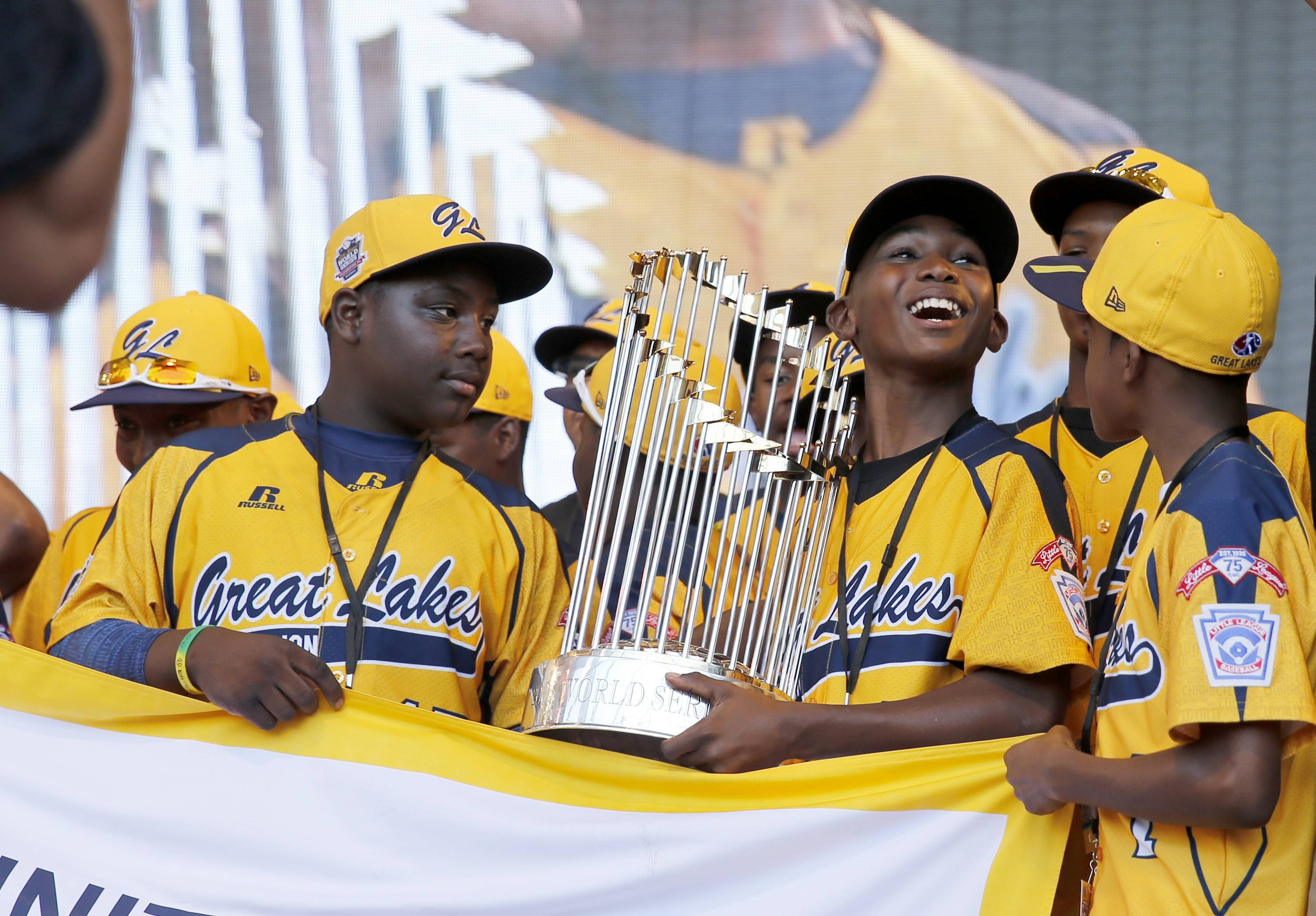 Members of the Jackie Robinson West All Stars Little League baseball team participate in a rally celebrating the team's U.S. Little League Championship Wednesday, Aug. 27, 2014, in Chicago.