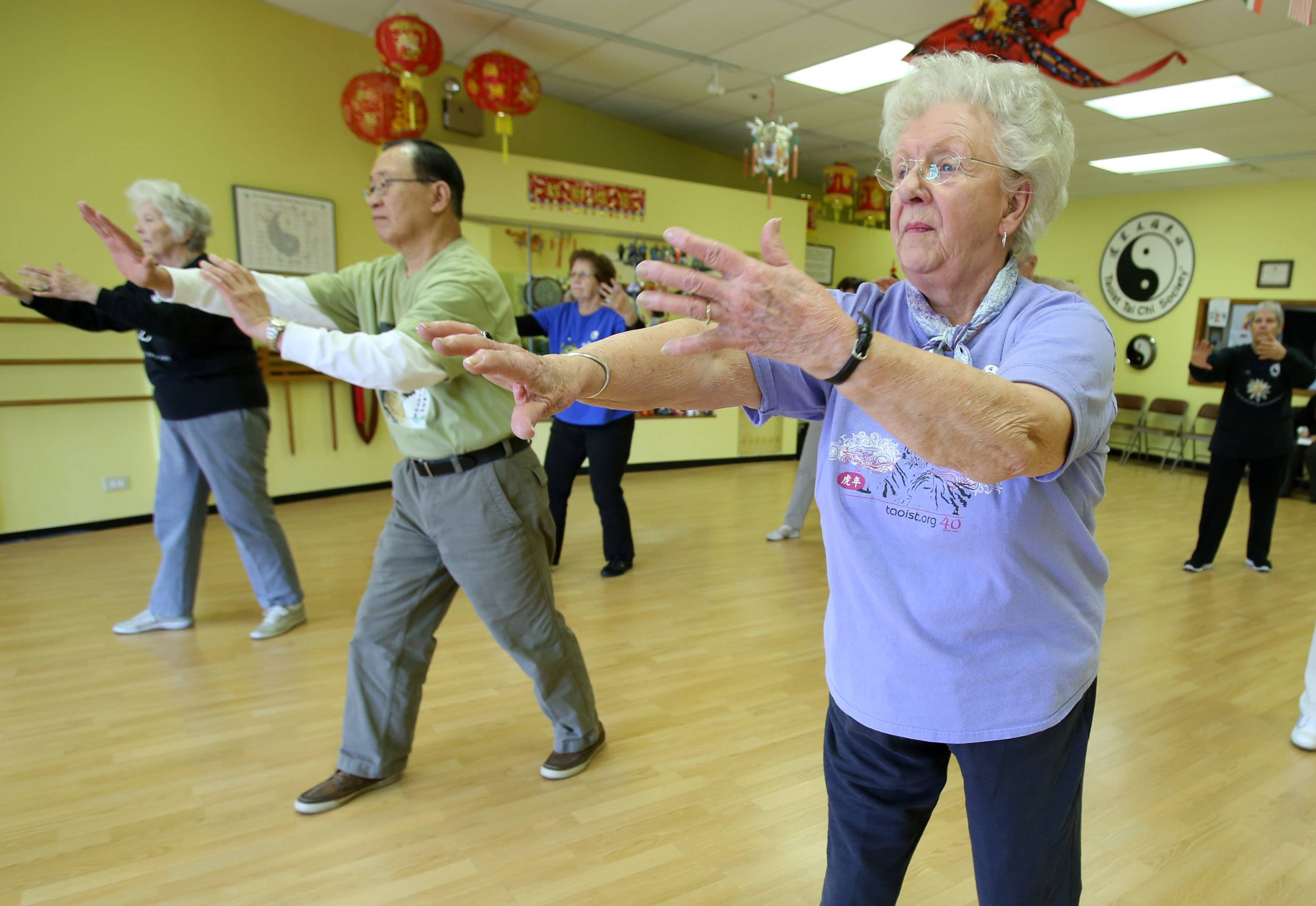 Maxine Kitts of Glenview takes a tai chi class at Taoist Tai Chi Center last year in Arlington Heights. Exercise programs such as tai chi can increase strength and improve balance.