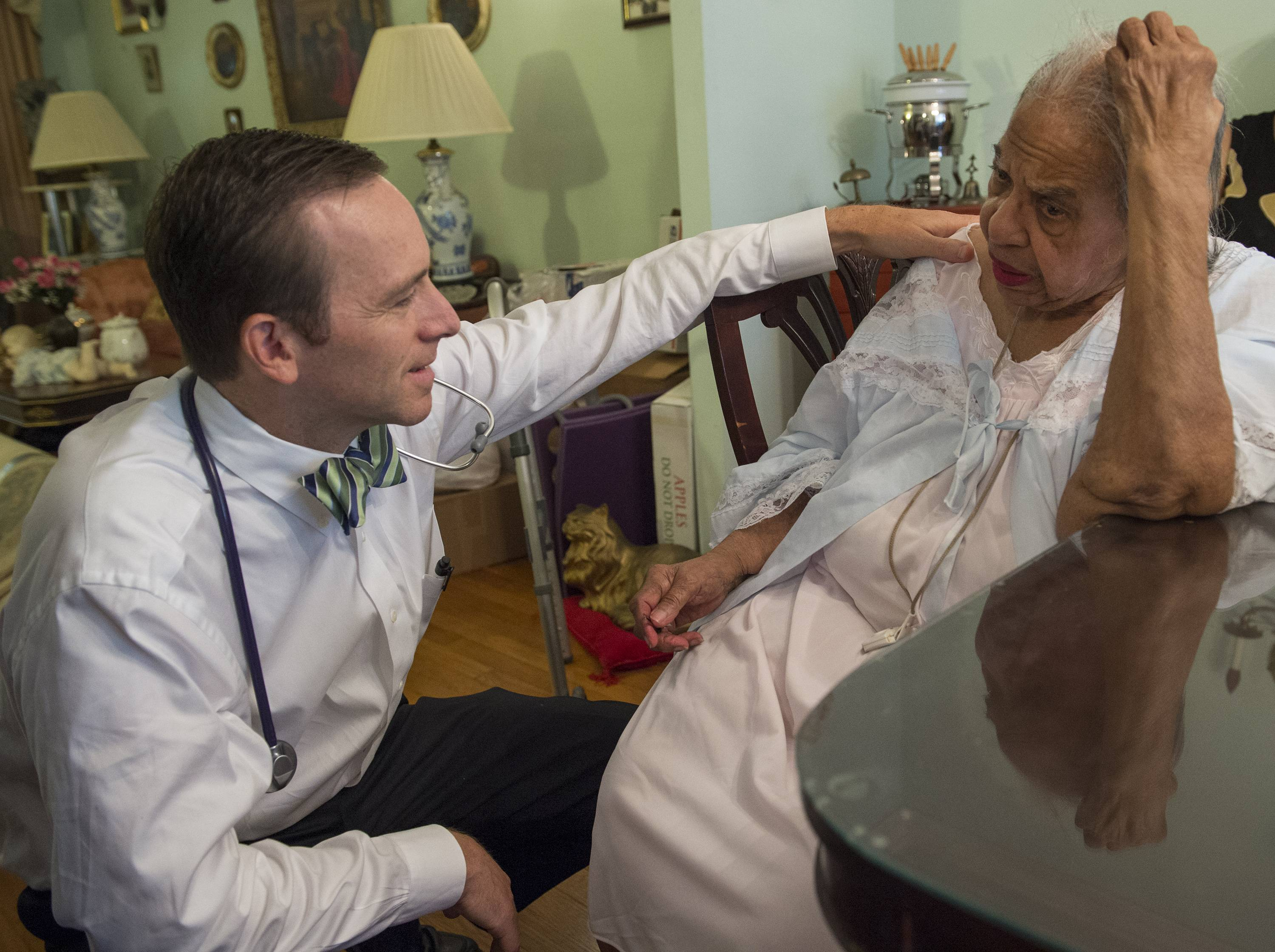 Dr. Eric De Jonge conducts a Medicare house call at the home of patient Beatrice Adams.