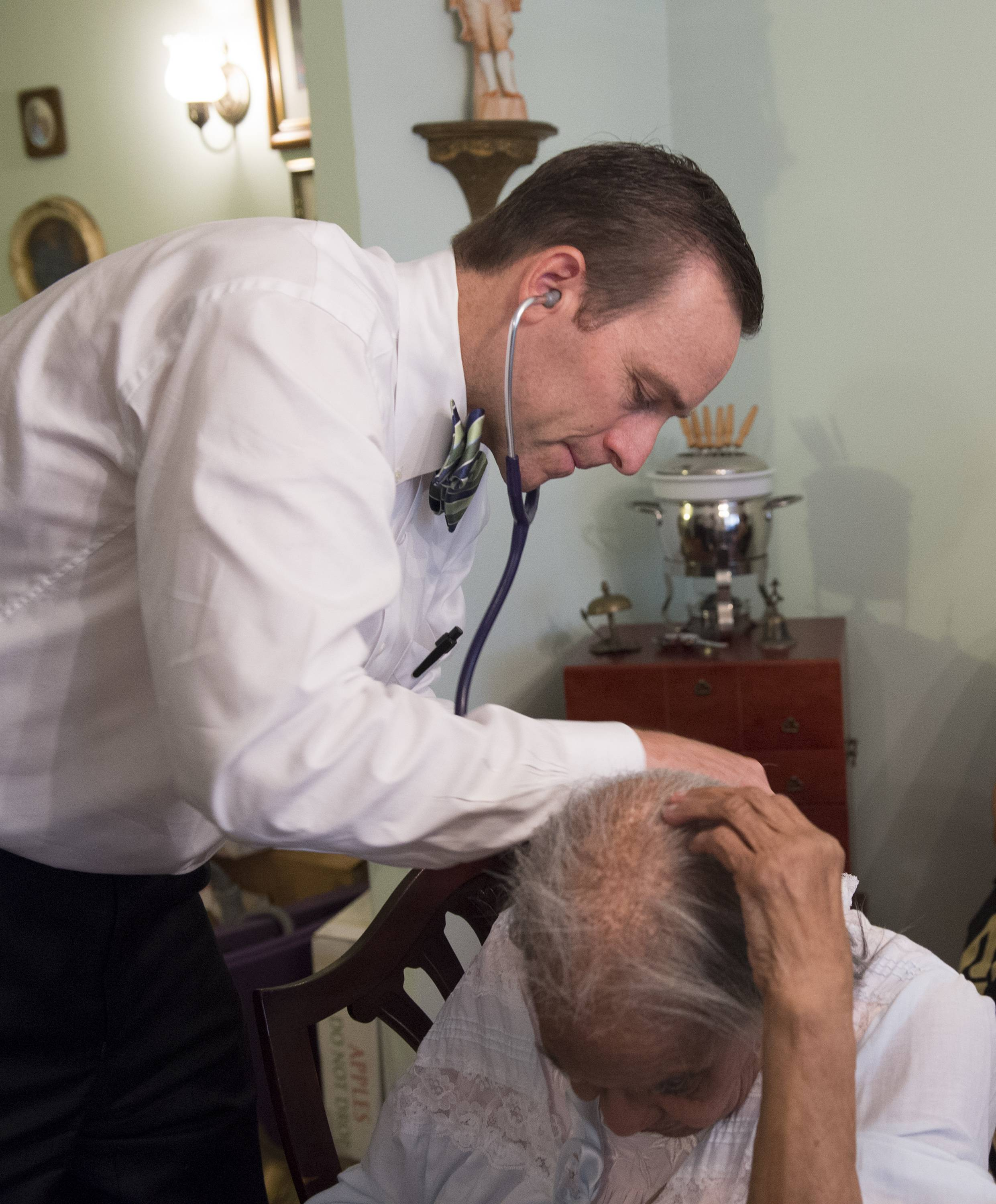 Dr. Eric De Jonge of Washington Hospital Center examines patient Beatrice Adams during a house call.