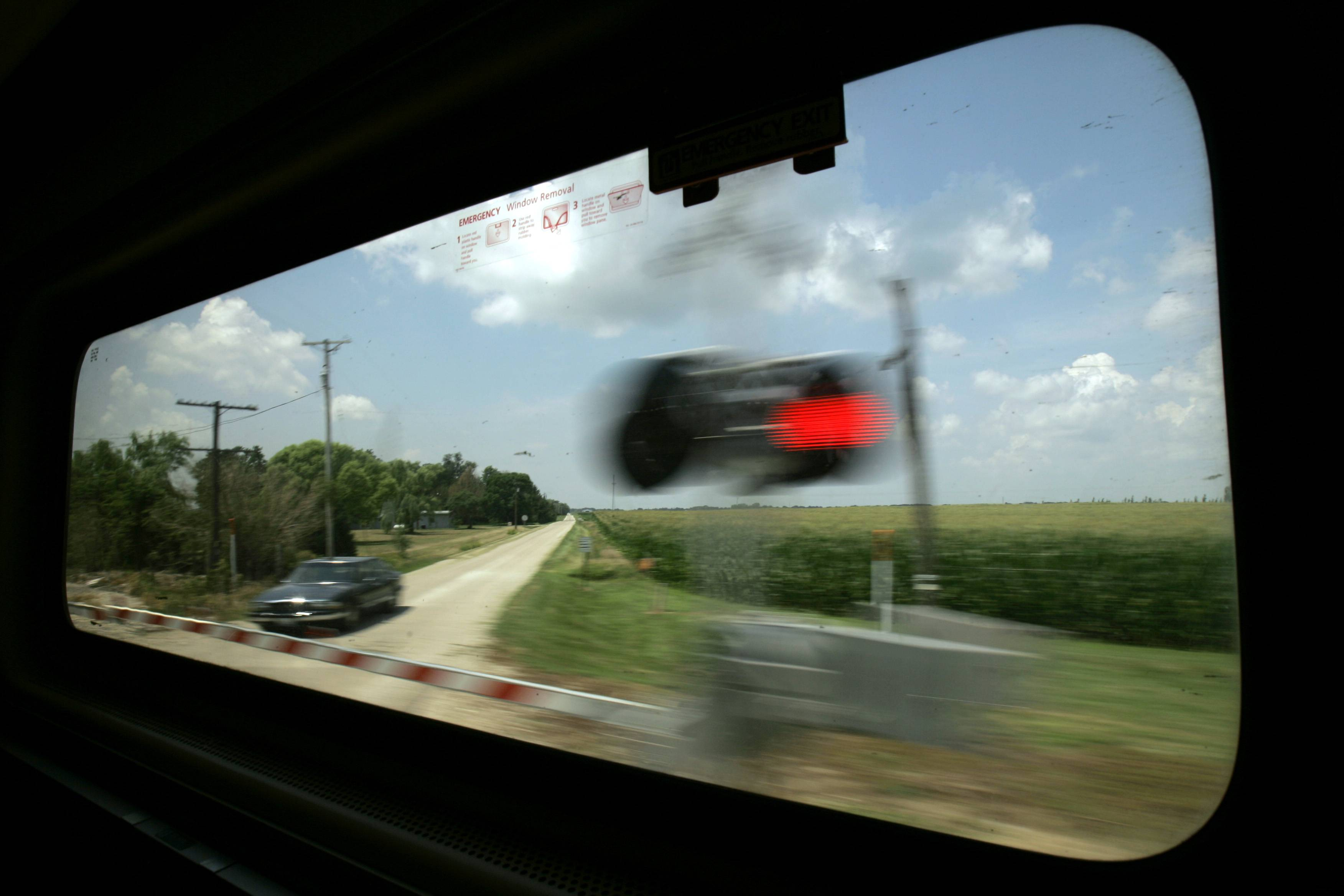 In this July 9, 2007, file photo Amtrak's Lincoln Service train passes Illinois cornfields en route to Chicago. The state of Illinois will spent $102 million to build a bridge over the Kankakee River along with other improvements as part of high-speed rail upgrades between Chicago and St. Louis.