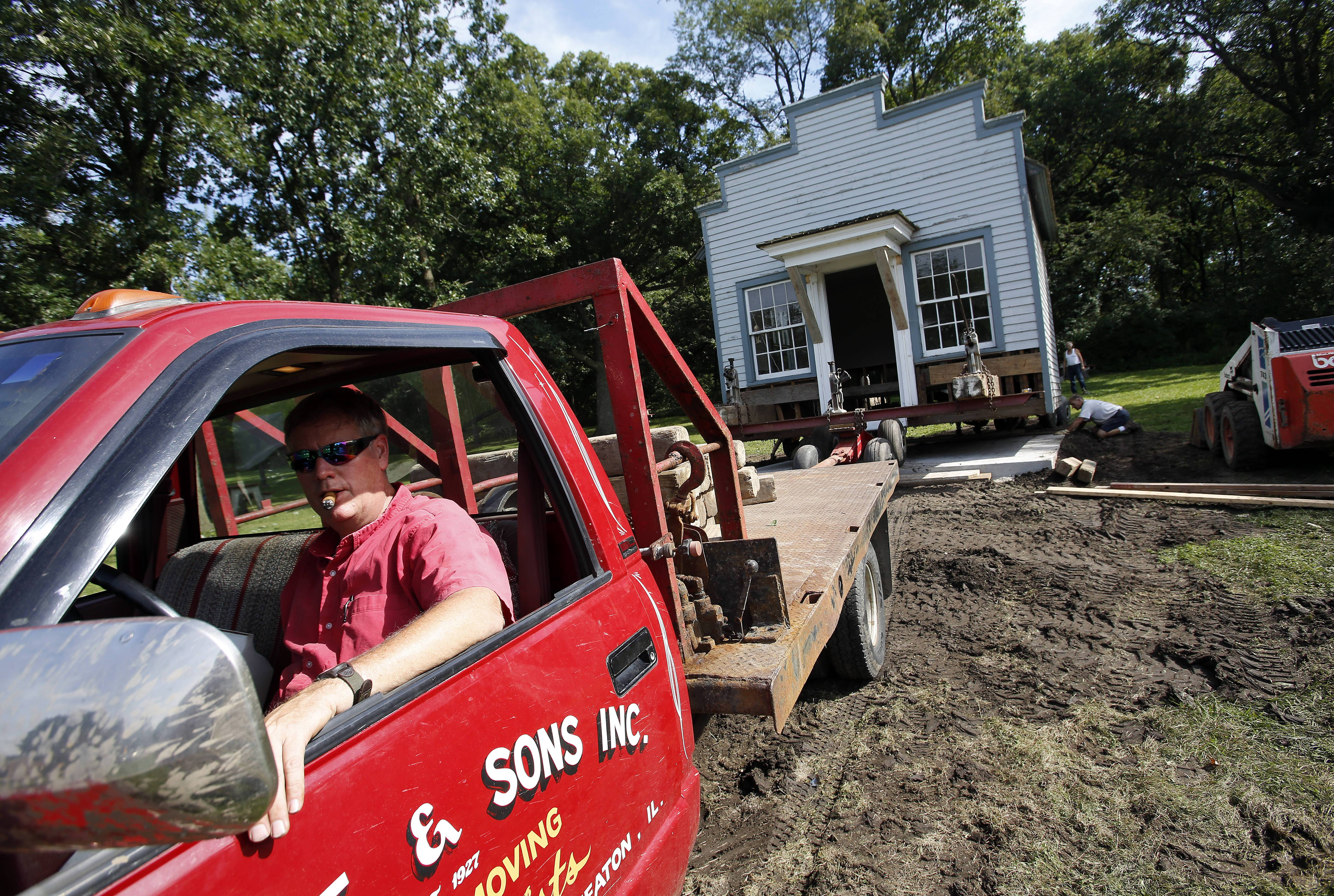 Gary Muehlfelt carefully pulls the historic Jones Law Office building to its new location in Langum Park along Rt. 25 near Devereaux Way in St. Charles Wednesday.