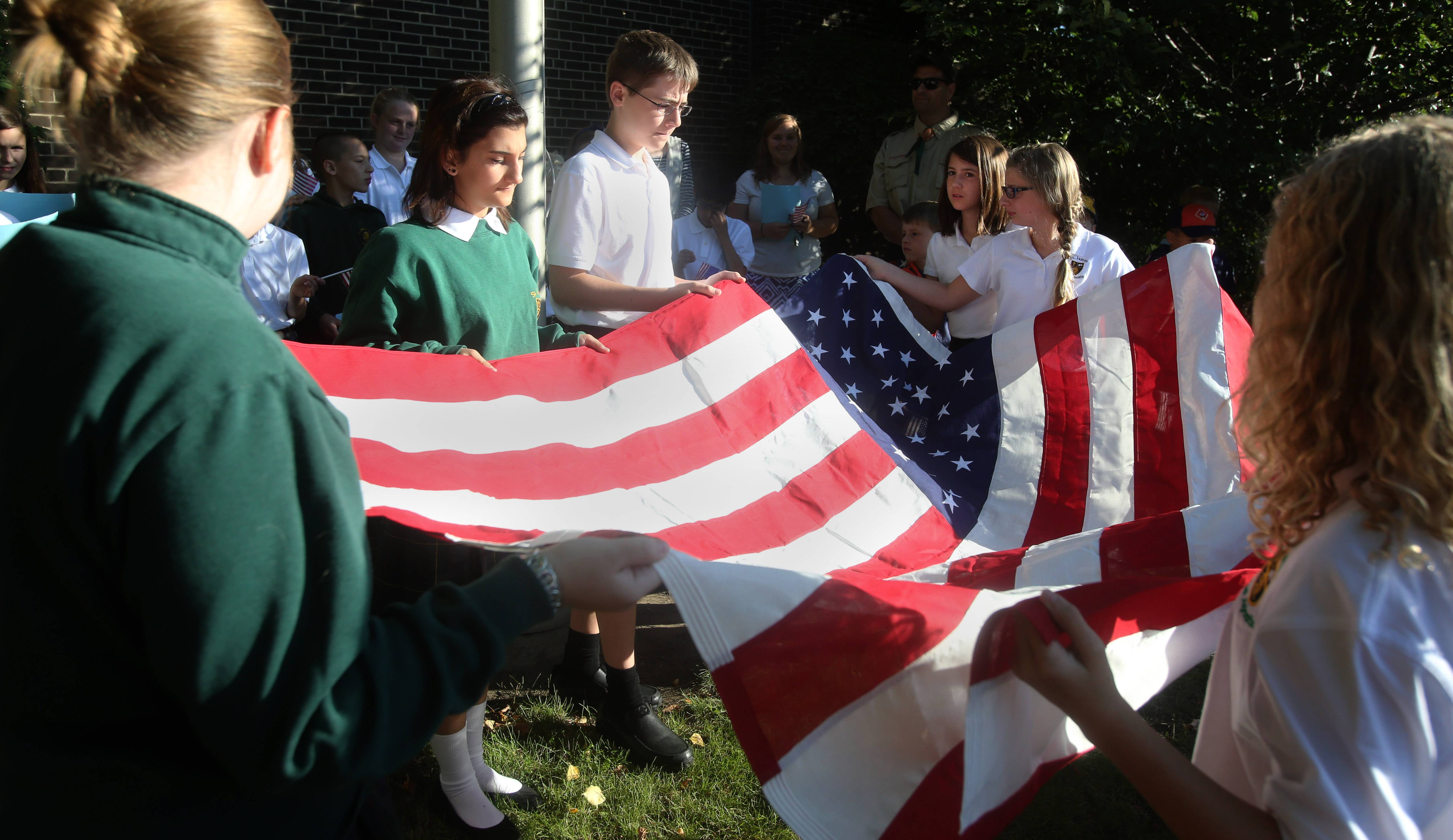 Students from St. James the Apostle school in Glen Ellyn prepare to fly its brand new 5x8 foot flag for the first time.