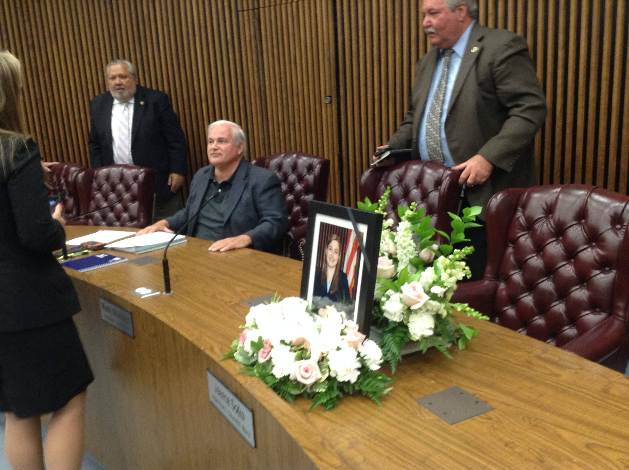 A picture and flowers honoring the late Des Plaines Alderman Joanna Sojka, who died Aug. 18 of an apparent stroke, was placed on the city council dais Tuesday night.