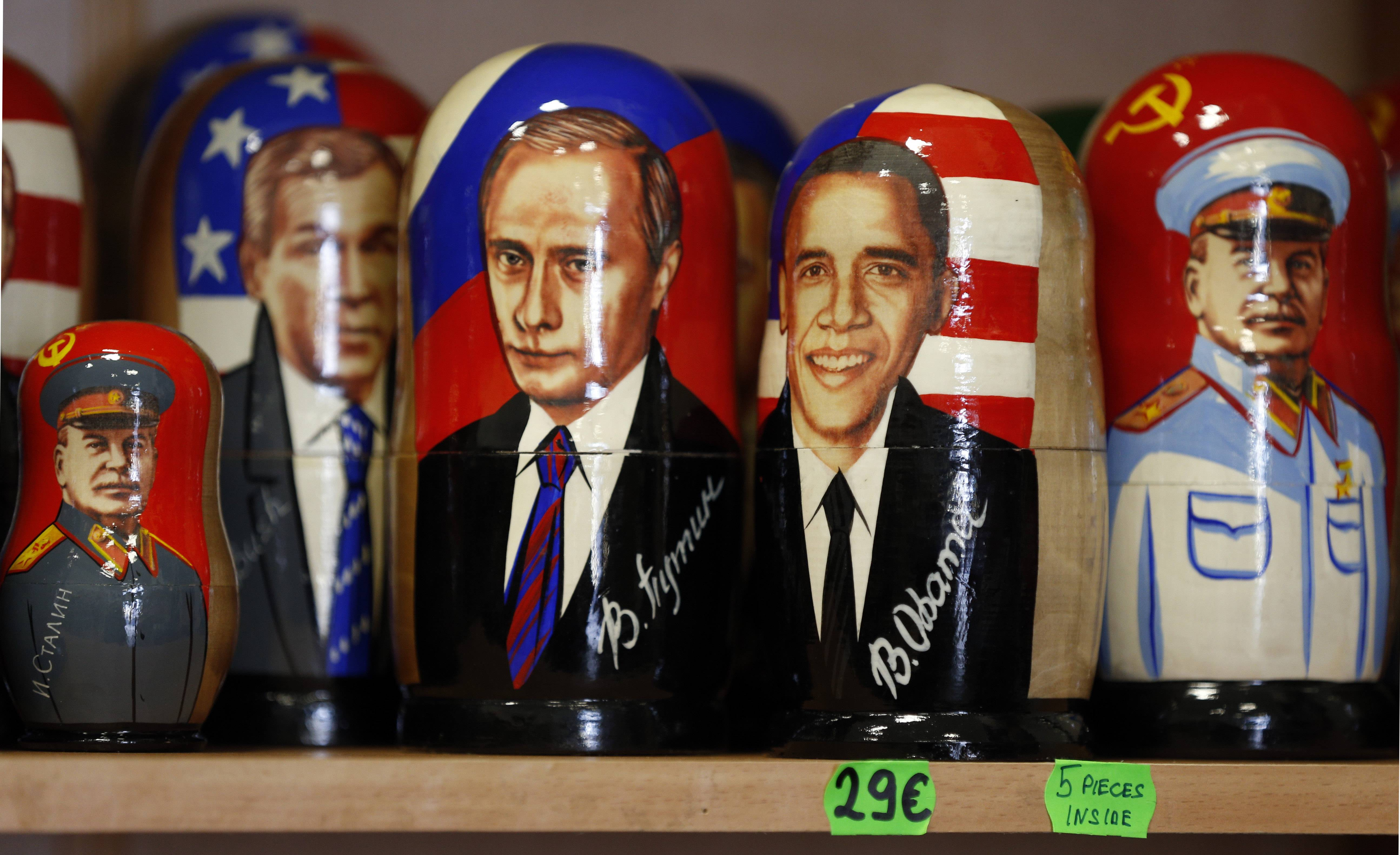 Traditional Russian Matryoshka wooden dolls depicting, from left, Soviet dictator Joseph Stalin, U.S. President George W. Bush, Russian President Vladimir Putin, U.S. President Barack Obama and Stalin again and are seen on a display in Tallinn, Estonia, Tuesday ahead of Obama's visit there.