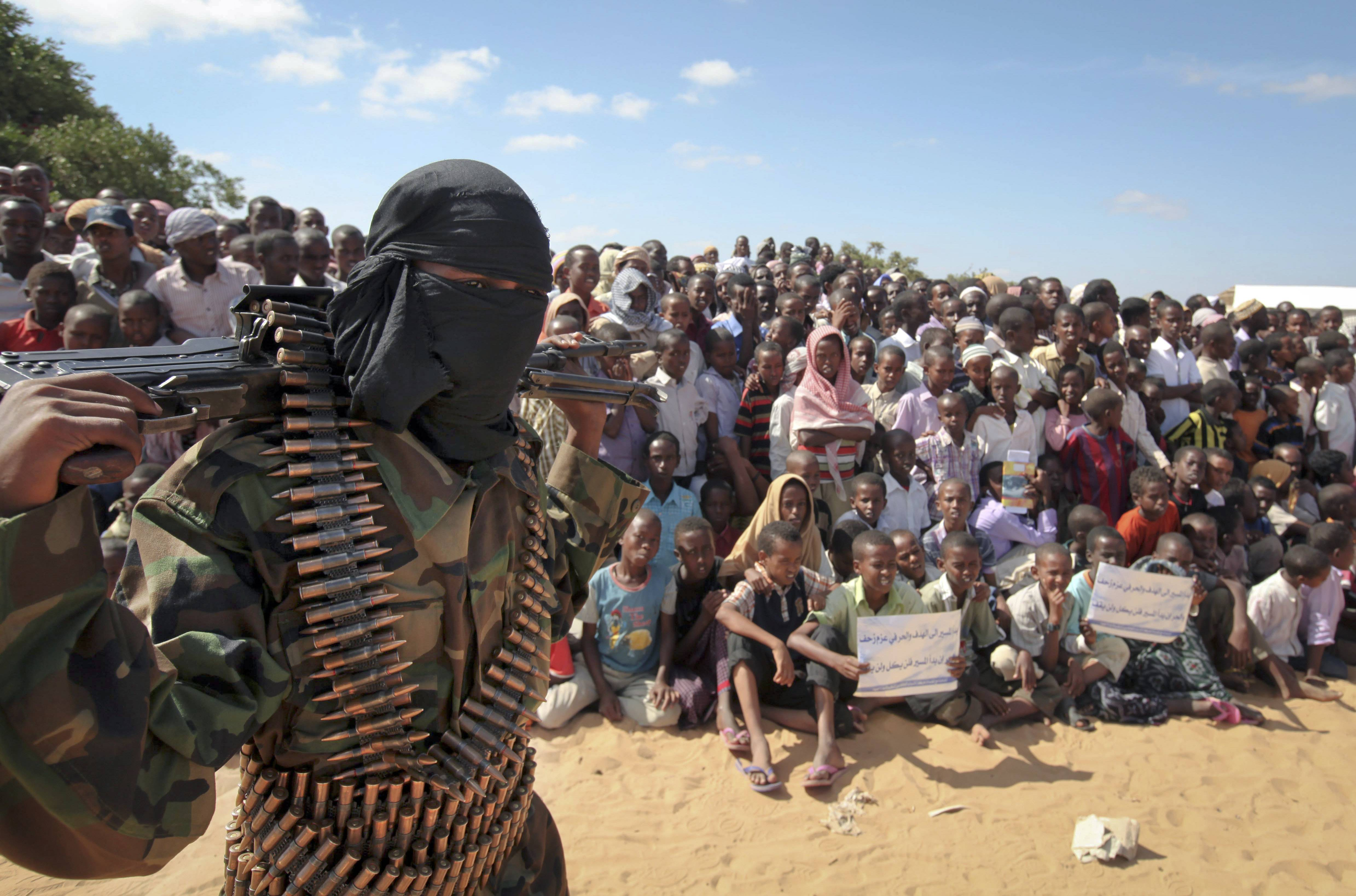 An armed al-Shabab member attends a rally in support of the merger of that group with al-Qaida, on the outskirts of Mogadishu, Somalia, Feb. 13, 2012. U.S. military forces targeted the Islamic extremist al-Shabab network in an operation Monday in Somalia, the Pentagon said.