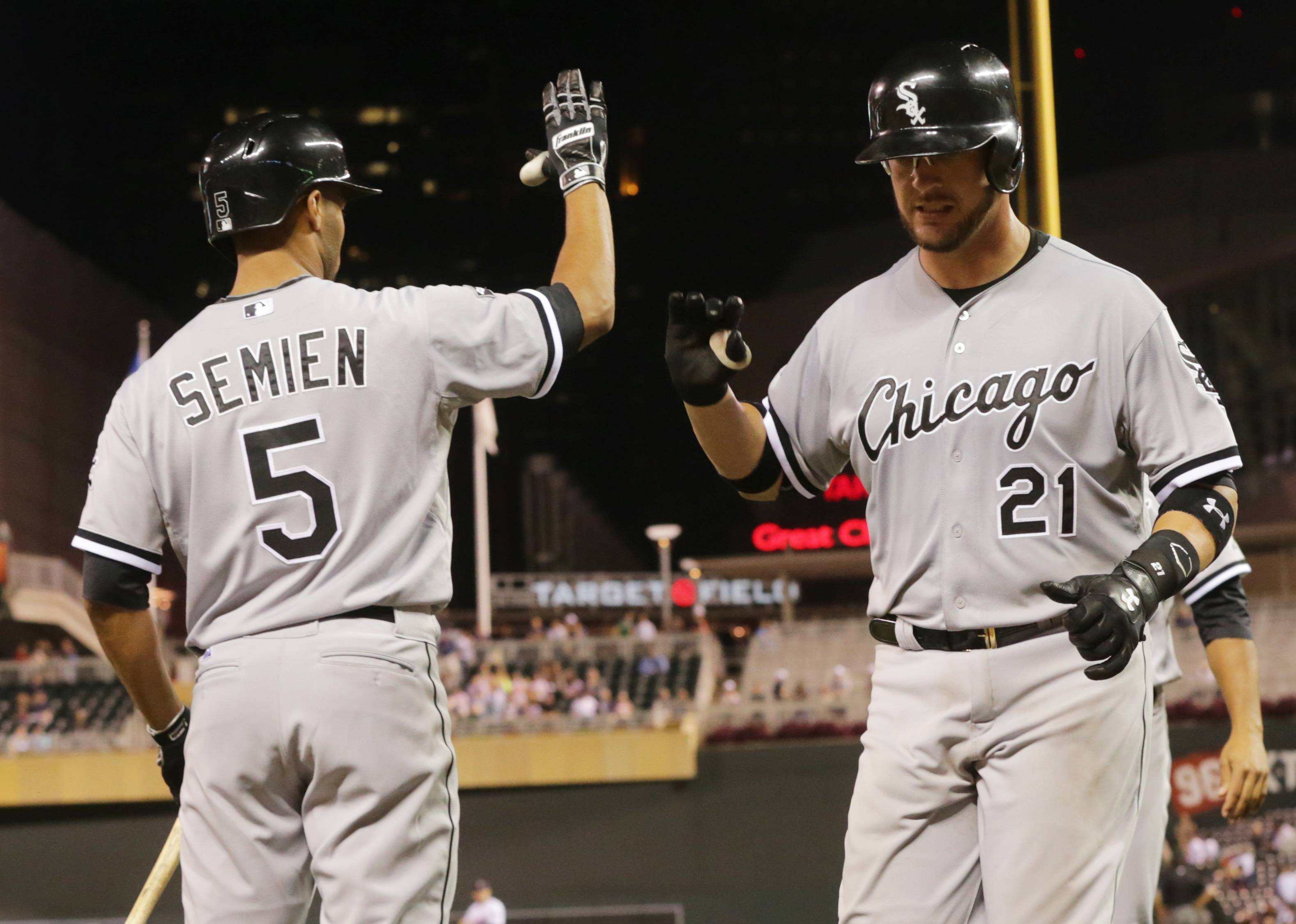 The White Sox's Tyler Flowers, right, is congratulated by Marcus Semien following his two-run home run off Minnesota Twins pitcher Lester Oliveros in the 10th inning of Tuesday night's game in Minneapolis. The White Sox won 6-3.
