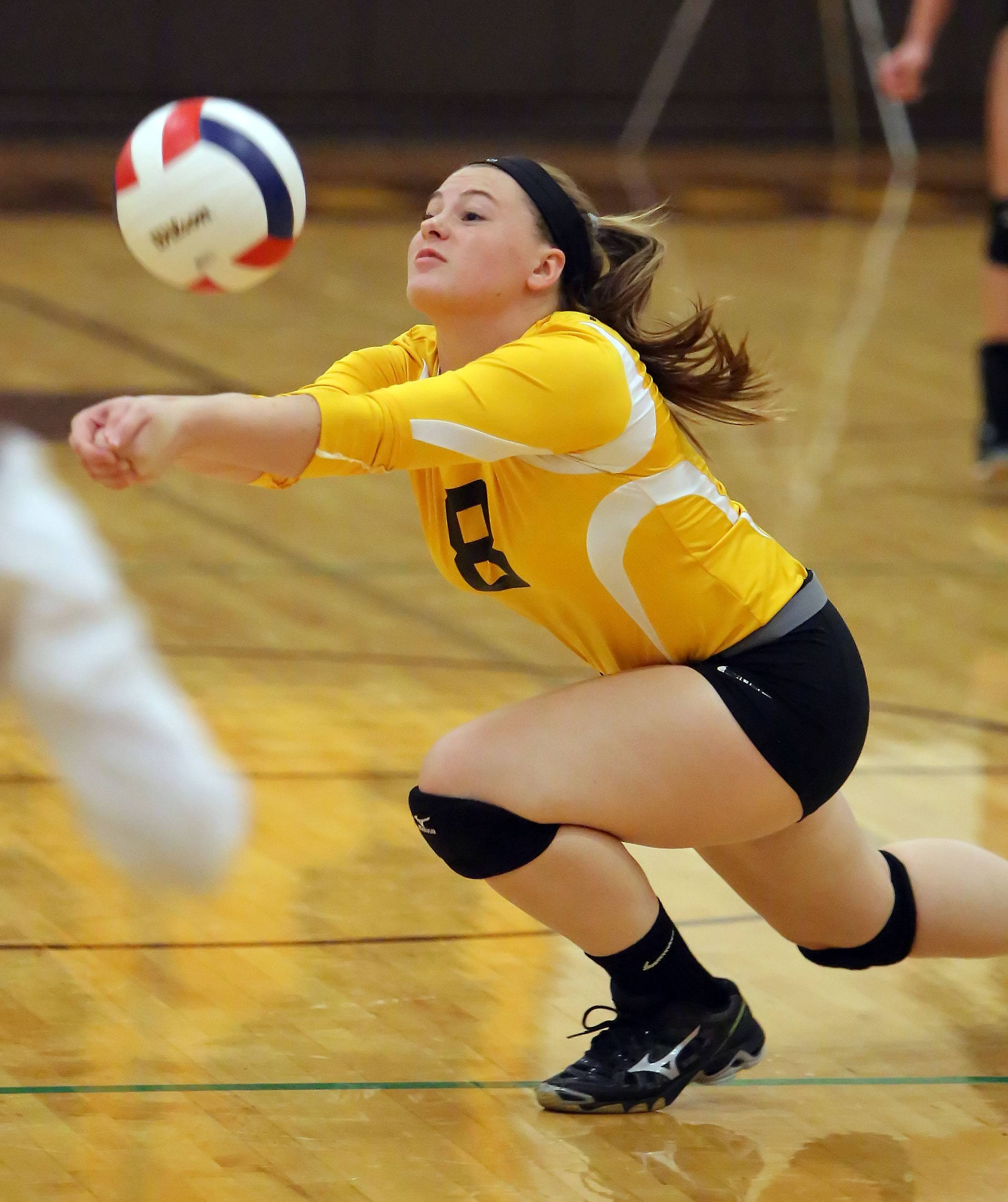 Carmel's Mamie Kenar dives for a ball against Lake Zurich on Tuesday in Mundelein.