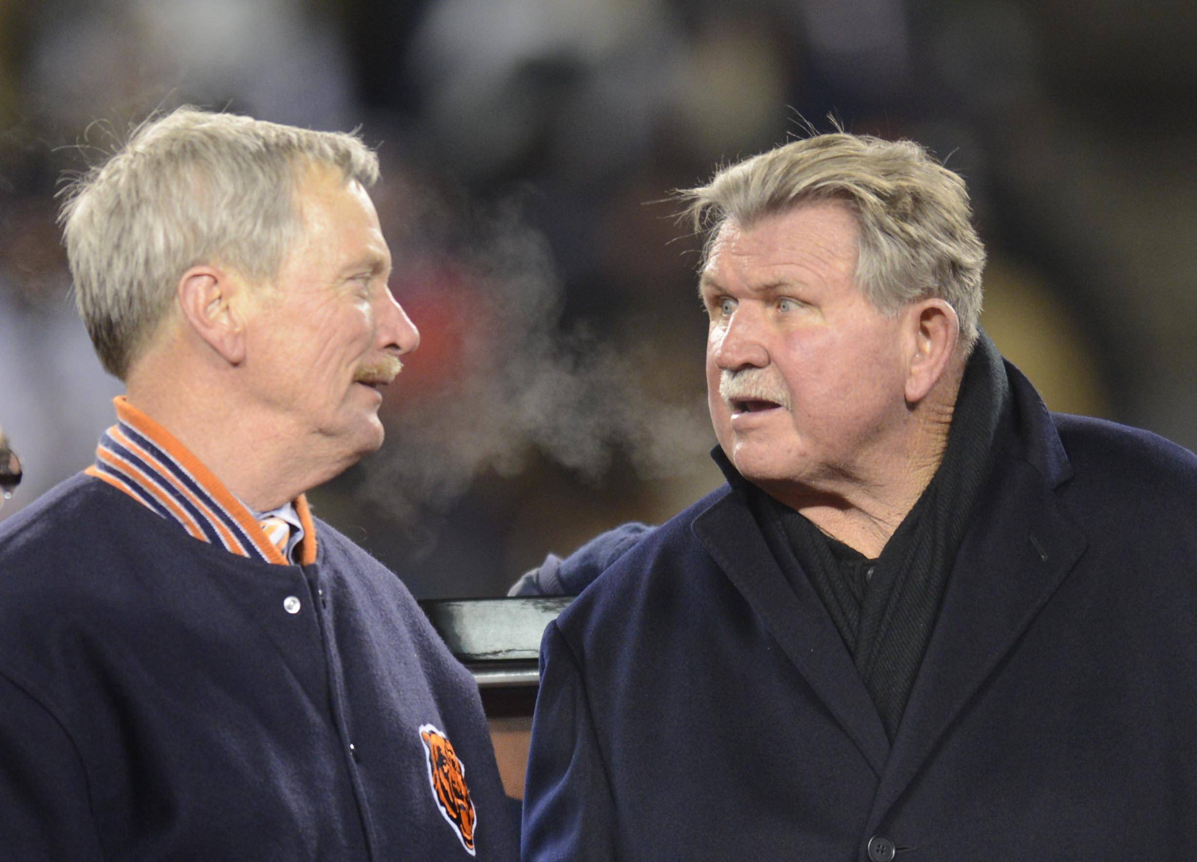 Former Bears head coach Mike Ditka talks with George McCaskey, chairman of the board of the Bears, at Soldier Field.