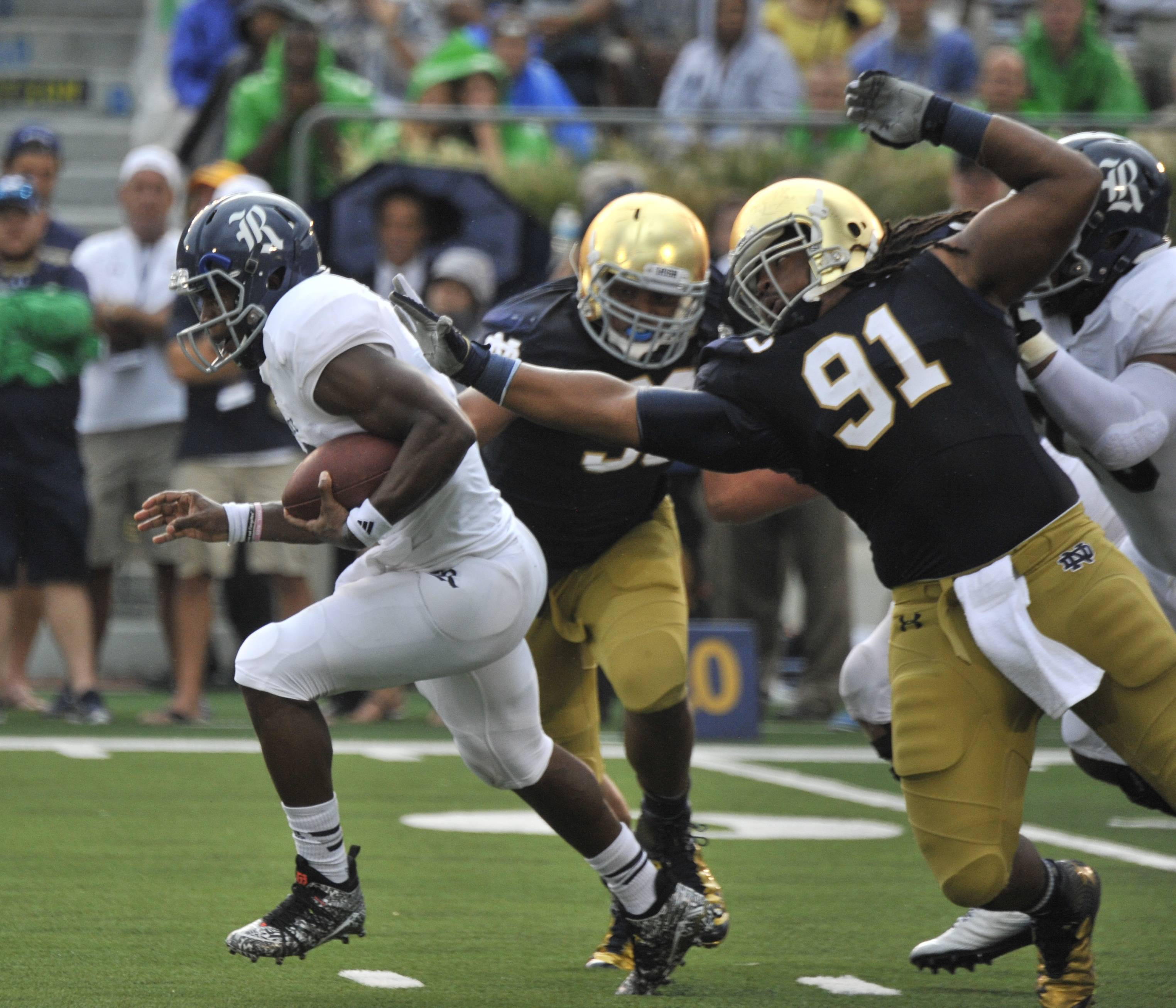 Rice quarterback Driphus Jackson is tackled by Notre Dame defensive end Sheldon Day during an NCAA football game with Notre Dame Saturday, Aug. 30, 2014 in South Bend, Ind. (AP Photo/Joe Raymond)