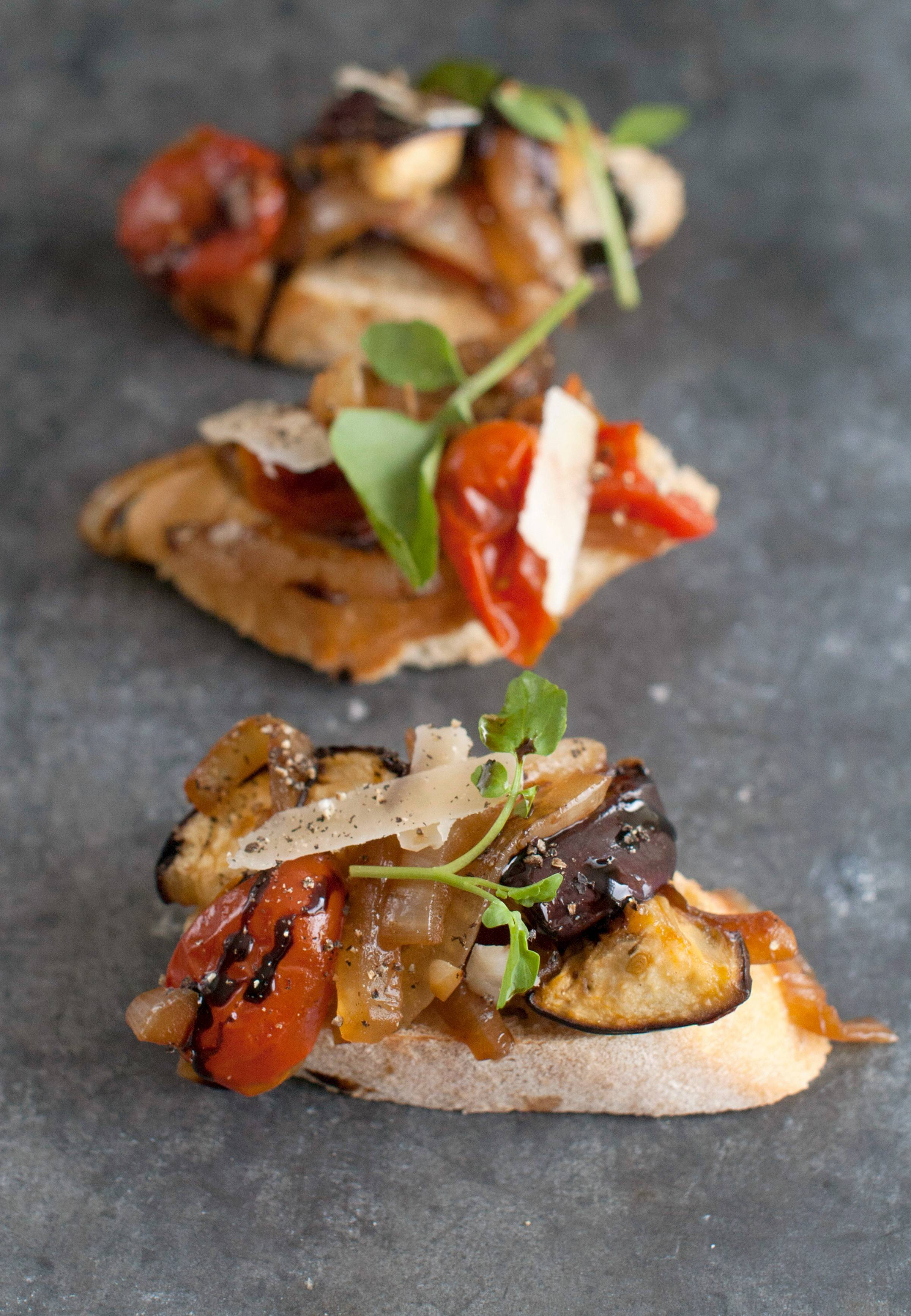 Salting and draining the eggplants and tomatoes removes excess water, which not only makes for a meatier texture, it also concentrates the flavors in this crostini appetizer.