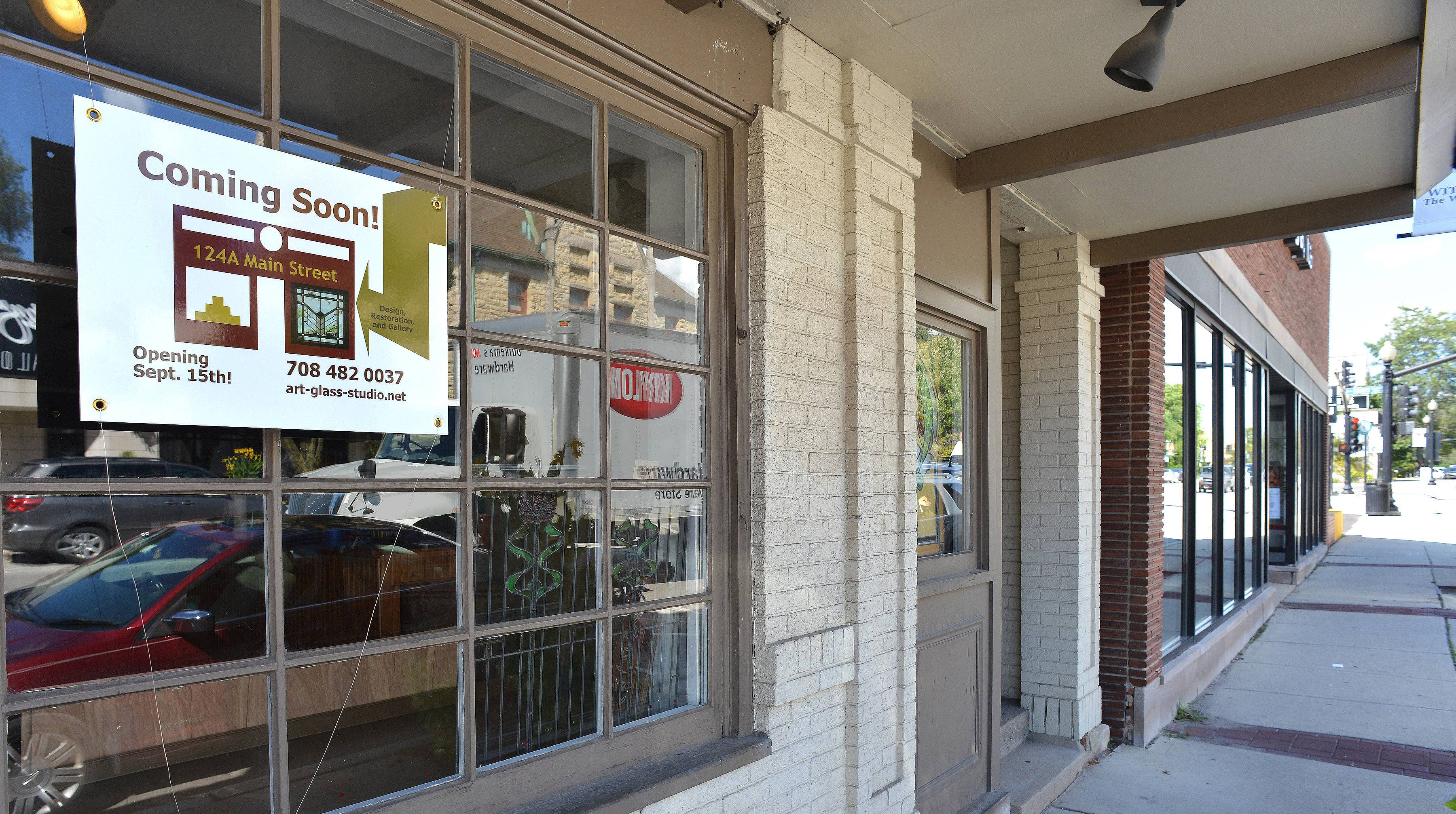 Several new businesses are moving into downtown Wheaton, including Art & Glass Studio at 124 N. Main Street.