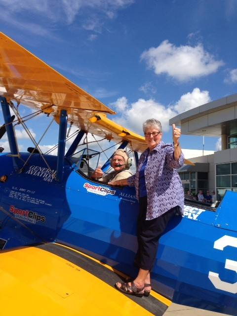 Armour Swanson with his wife Bev celebrate his ride in the 1942 Boeing Stearman at Chicago Executive Airport in Wheeling.