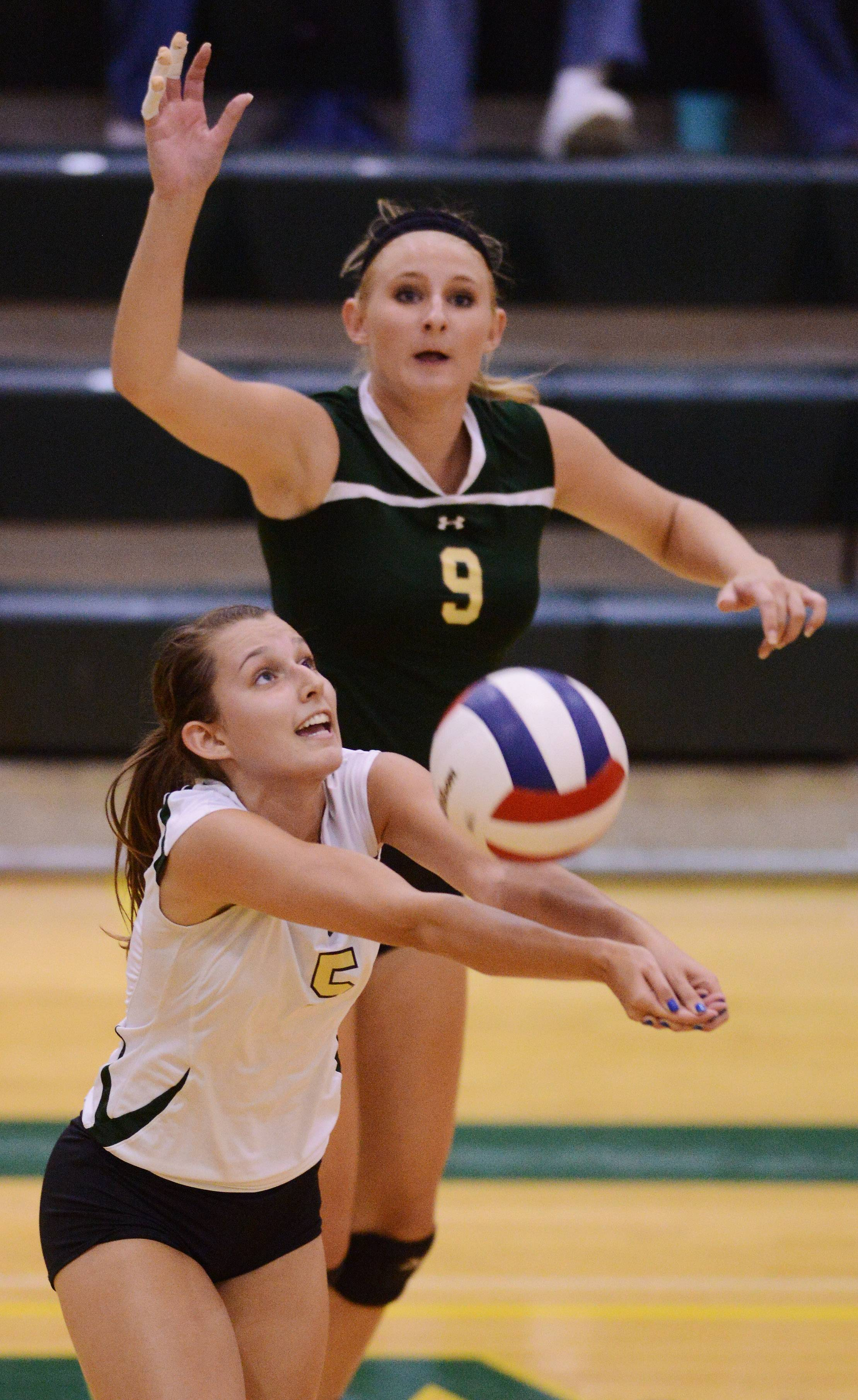 Fremd's Aubrey Stegich gets a dig as teammate Hope Schroeder gets ready for a kill during Tuesday's volleyball match with Hersey.