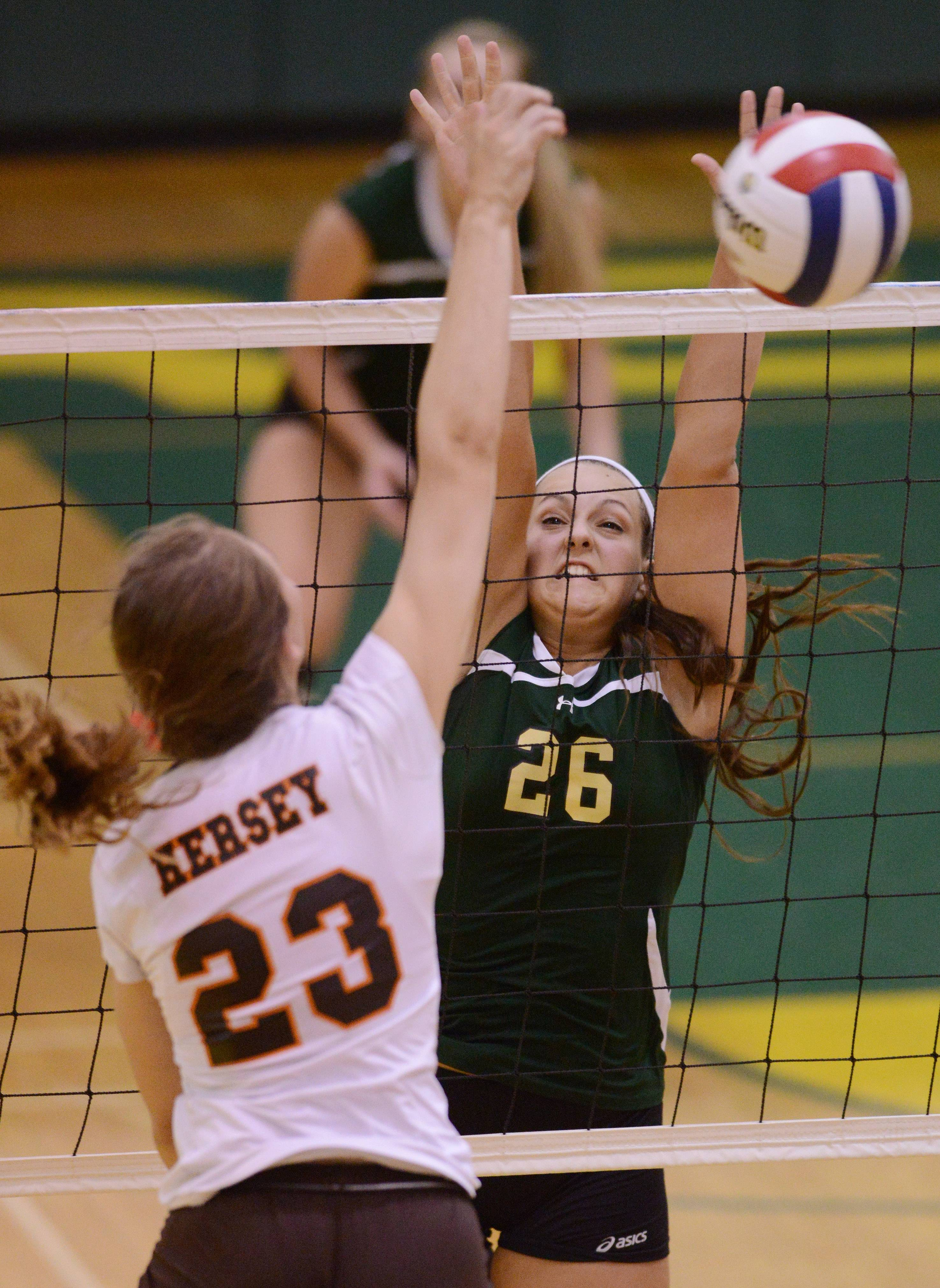 Fremd's Anna Bielinski tries to block a ball hit by Hersey's Liz Fuerst during Tuesday's volleyball match in Palatine.