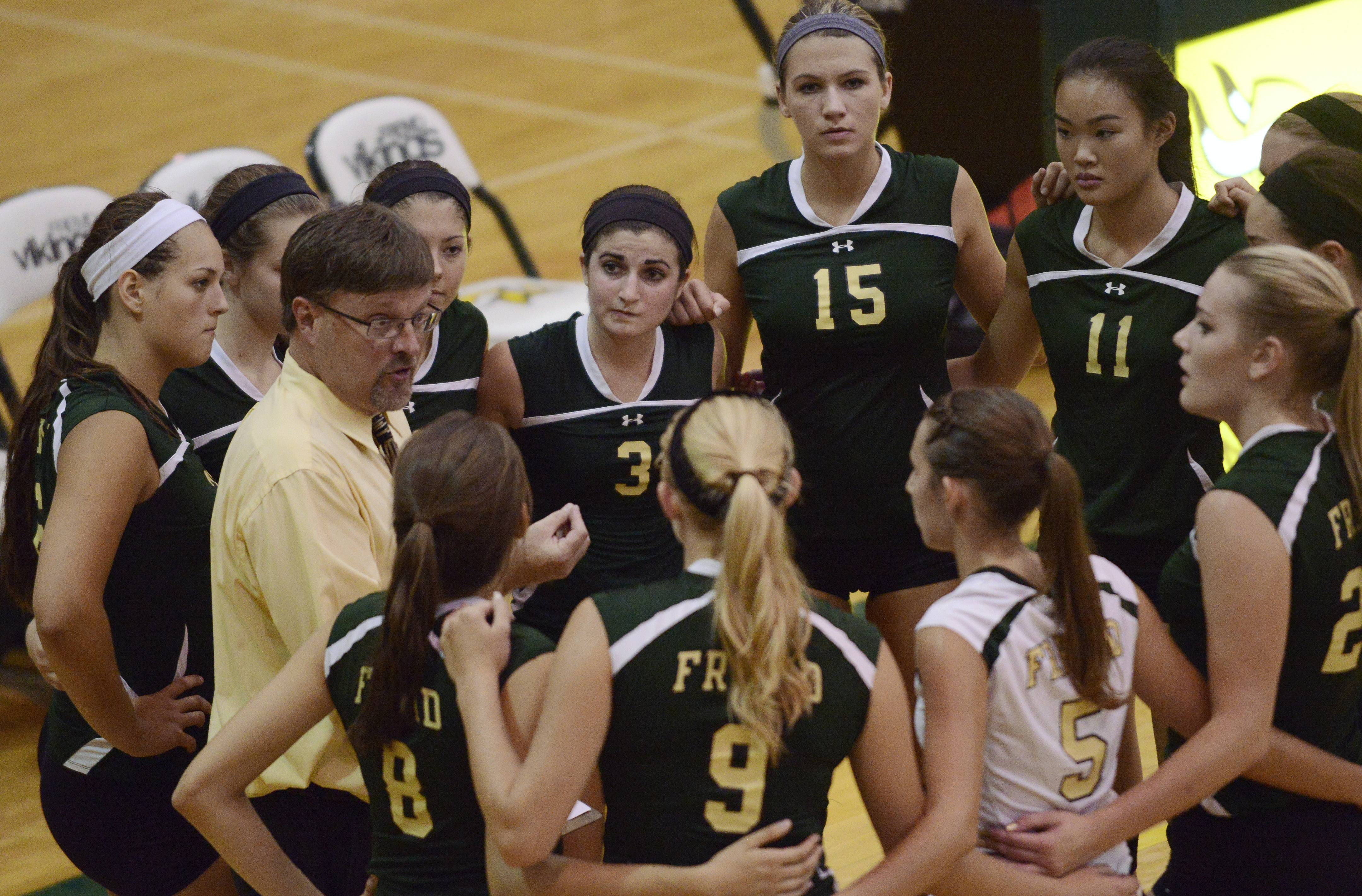 Fremd coach Curt Pinley talks with his team between game during a match with Hersey.