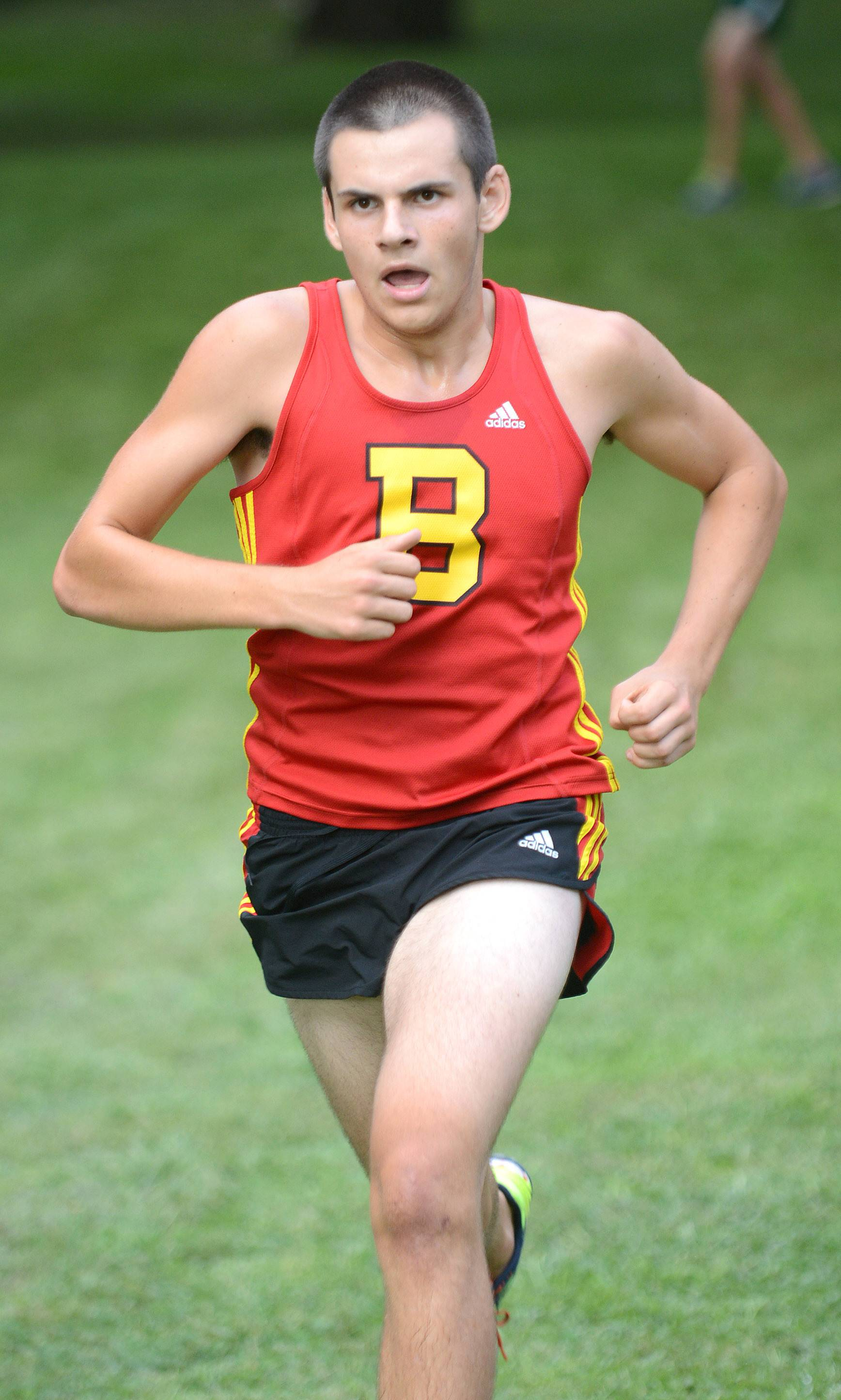 Batavia's Zachary Choffin nears the finish line at the Elgin Invite cross country meet at Lords Park in Elgin on Tuesday. He would cross first for his varsity team.